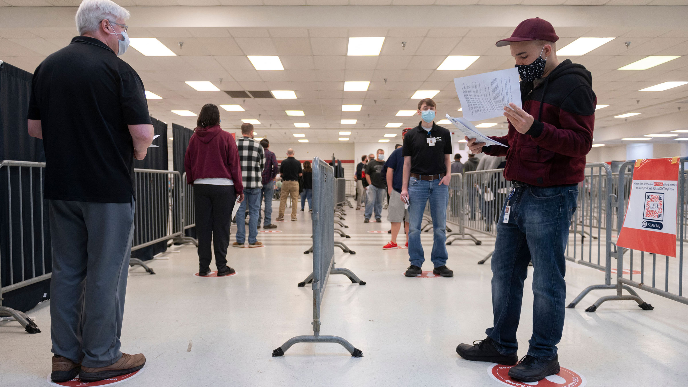People wait in line to get a Covid-19 vaccine in Lynchburg, Virginia, on March 13.