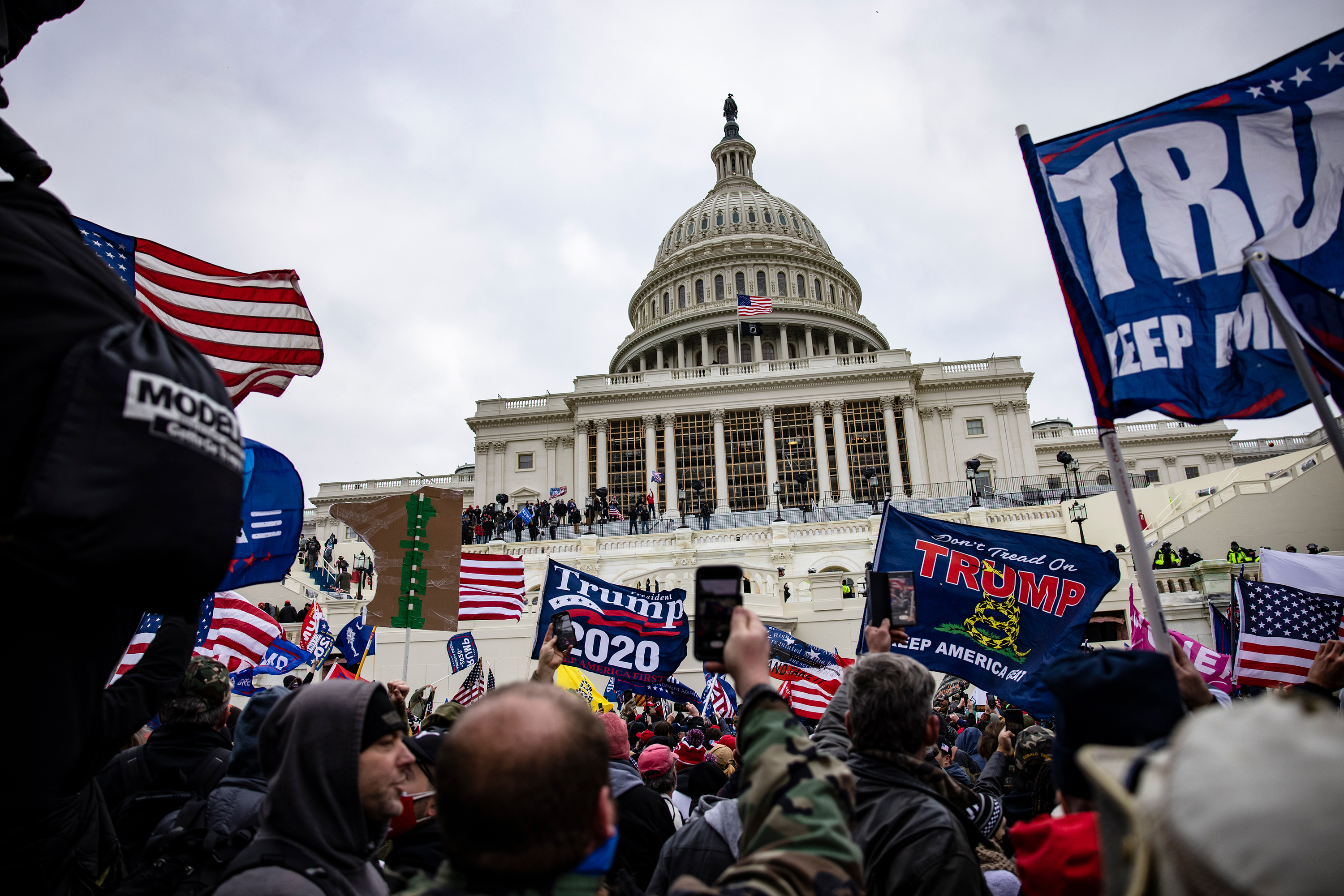 People storm the Capitol building on January 6, in Washington, DC.