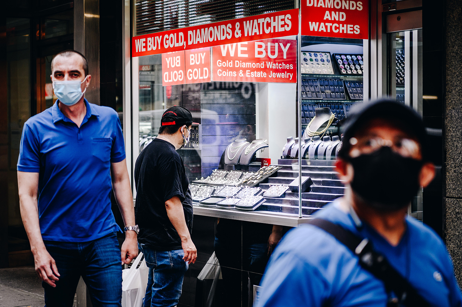 A pedestrian wearing a protective mask window shops in the Diamond District in New York, on June 10.