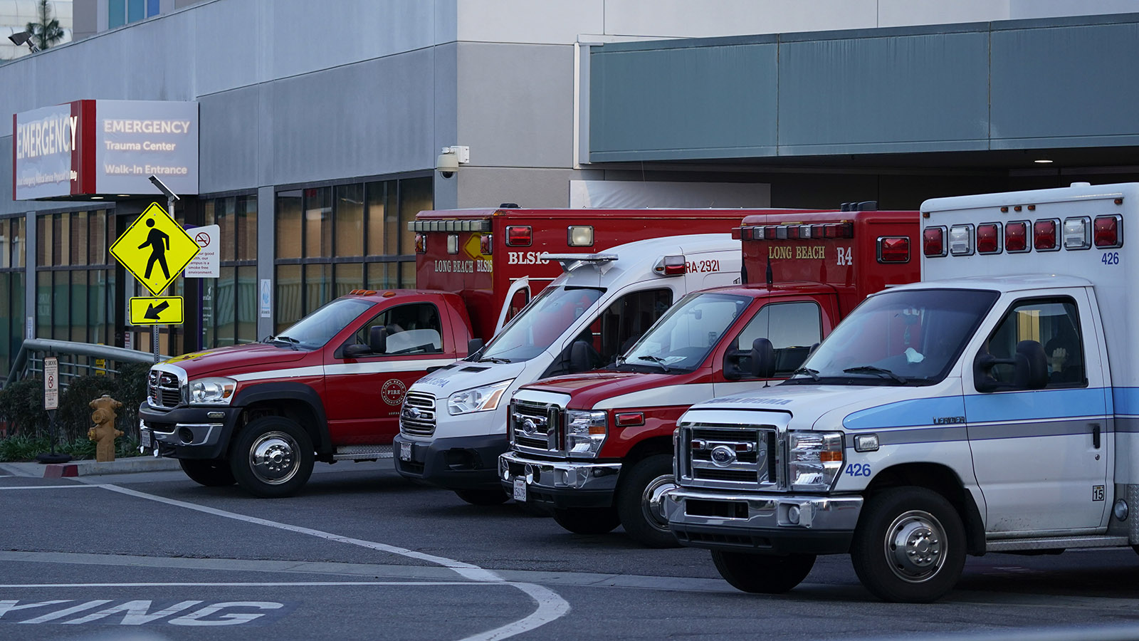 Ambulances are parked outside an emergency room entrance at Long Beach Medical Center Tuesday, January 5, in Long Beach, California.