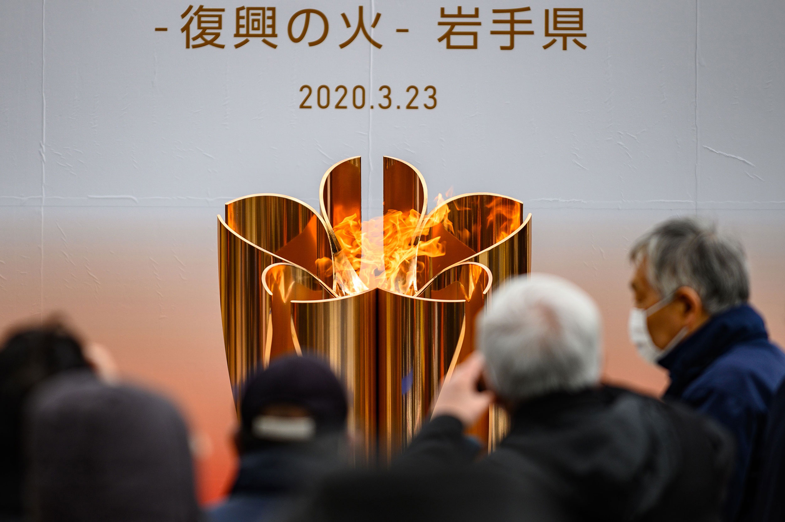 The Tokyo 2020 Olympic flame is displayed at Ofunato, Iwate prefecture on March 23.