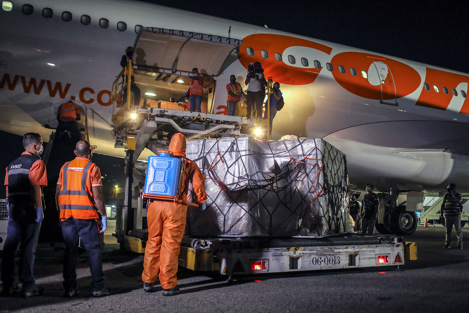 A shipment of China's Sinopharm vaccine is unloaded in Caracas, Venezuela, on March 1.