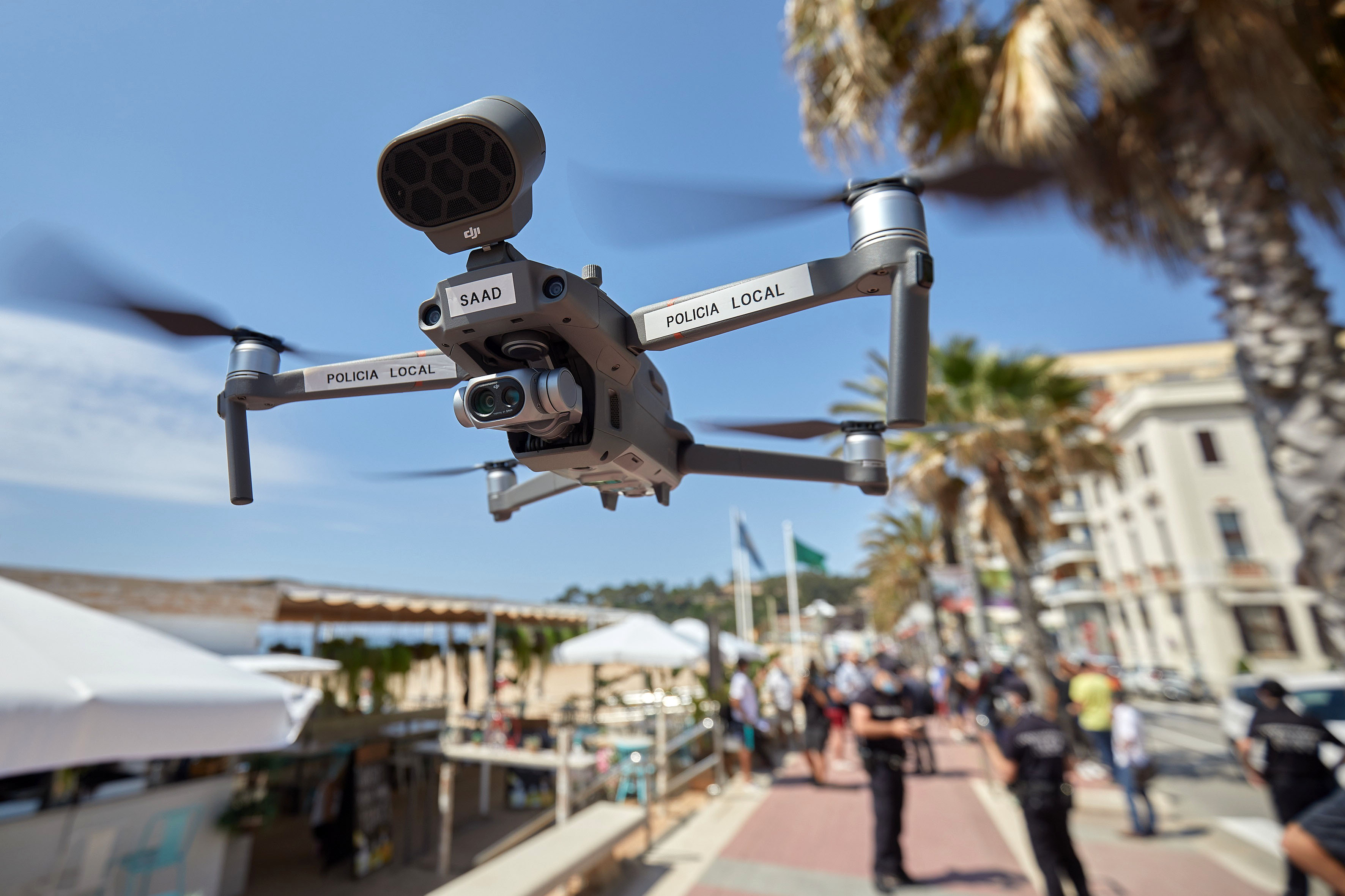 Police use a drone at a beach in Lloret de Mar, Spain, on June 22.