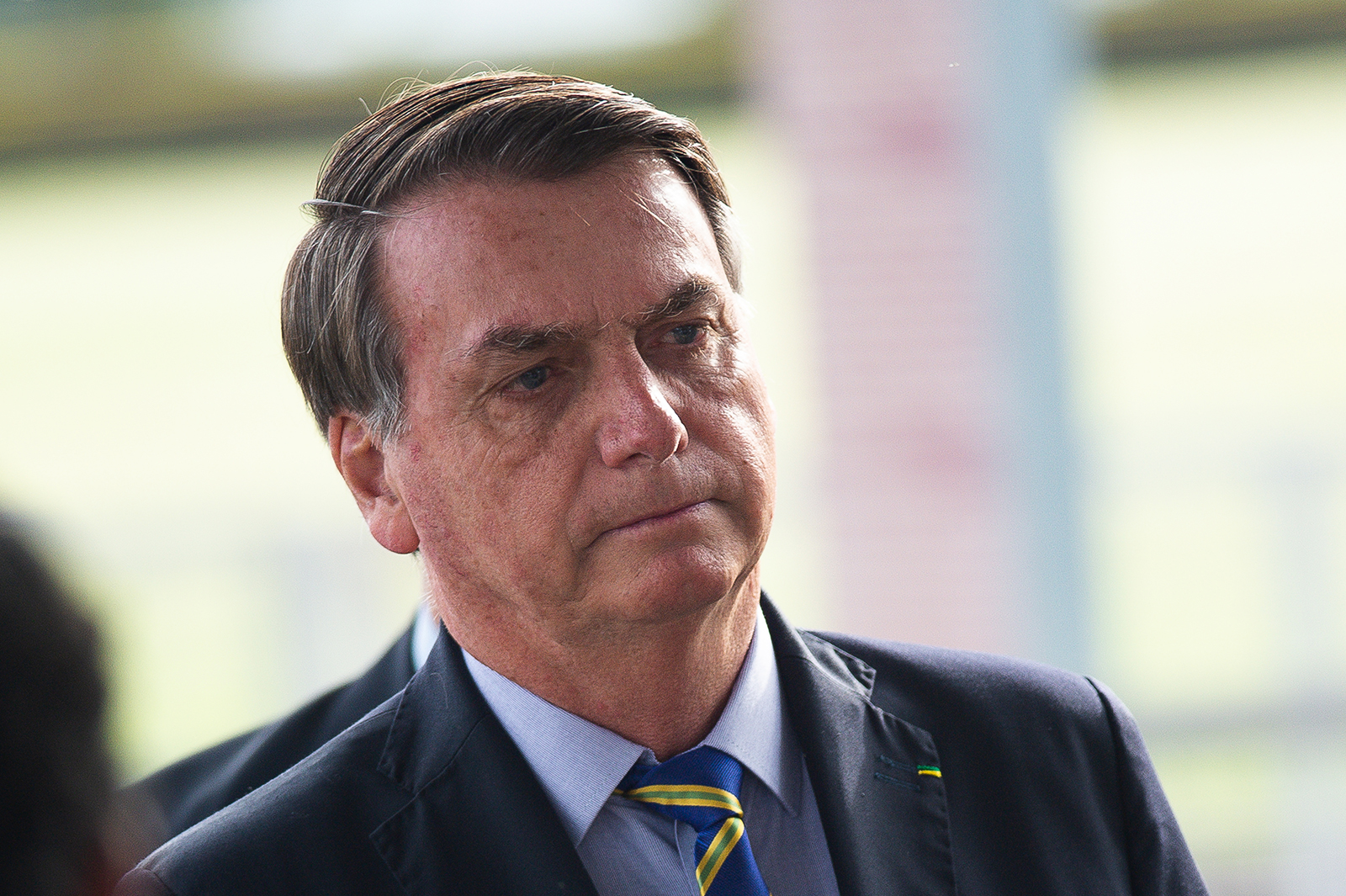 Brazilian President Jair Bolsonaro talks to supporters of his government on Wednesday, May 6, in Brasilia.