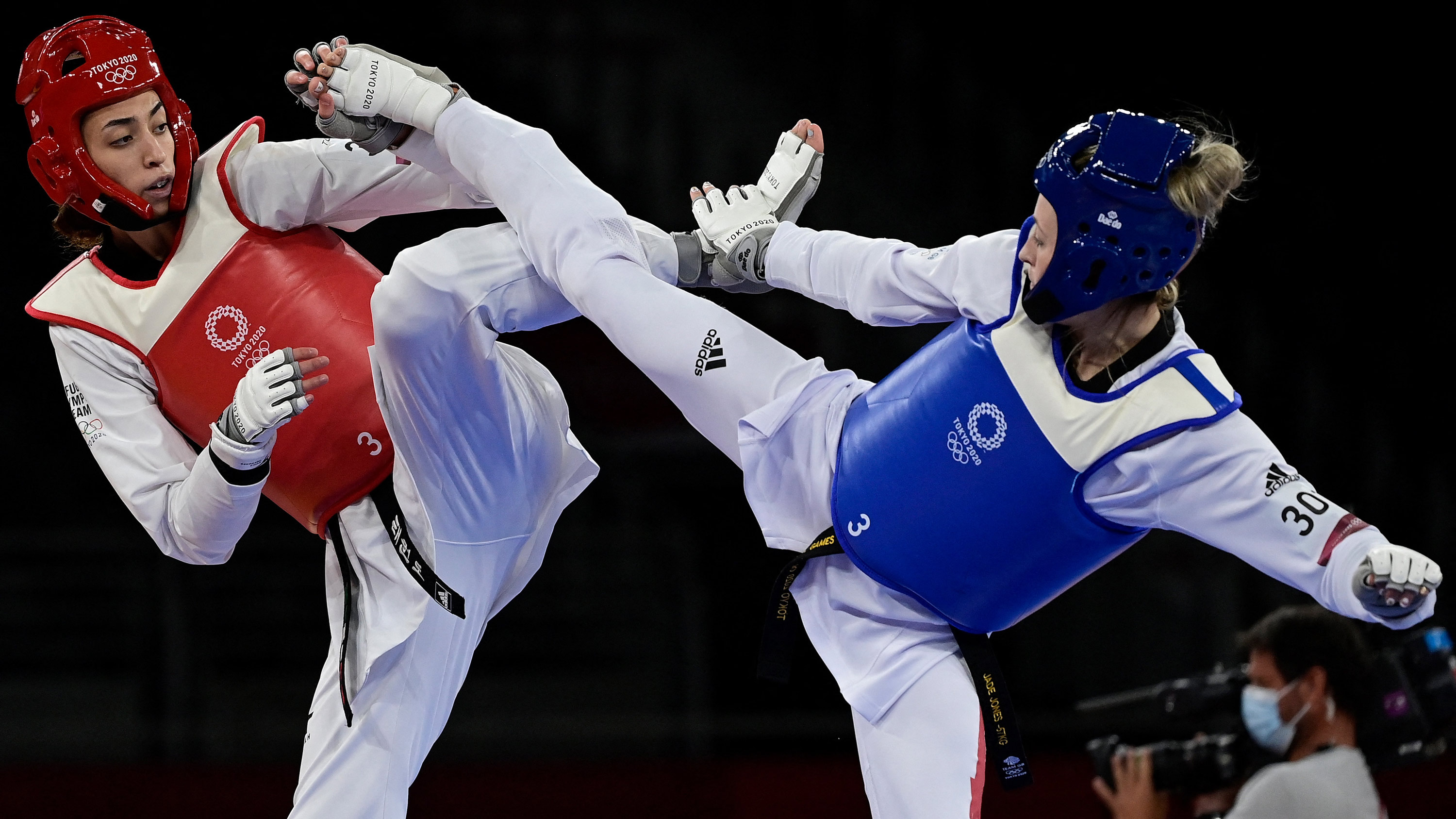 Britain's Jade Jones, right, and Refugee Olympic Team's Kimia Alizadeh Zenoorin compete in the taekwondo -57kg elimination round bout on July 25.