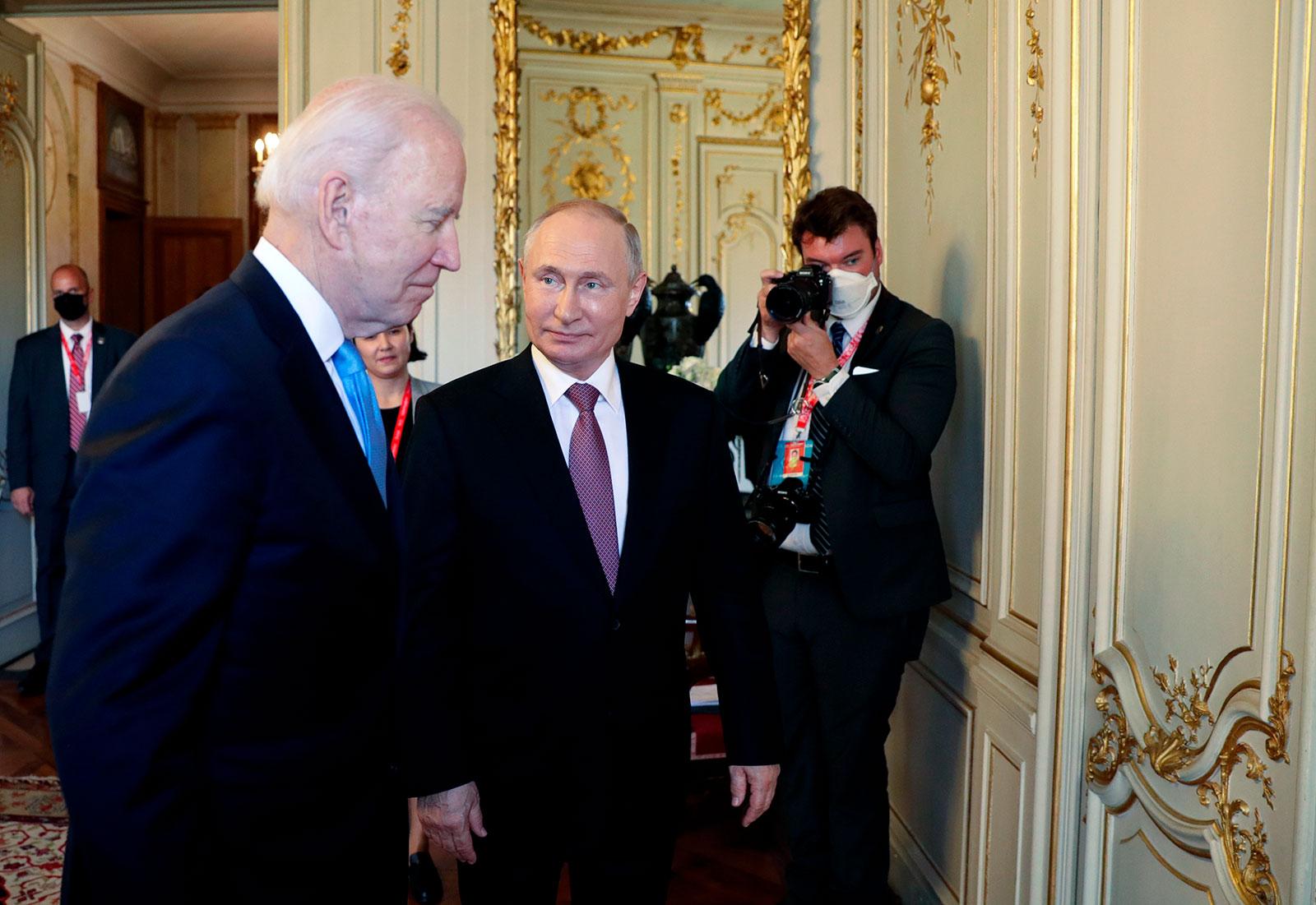 US President Joe Biden and Russian President Vladimir Putin walk in a hall during their meeting at the Villa la Grange in Geneva.