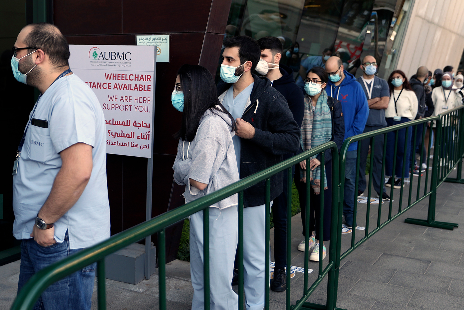 Frontline medical workers stand in line to get the Pfizer-BioNTech COVID-19 vaccine during a nationwide vaccination program at the American University Medical Center in Beirut, Lebanon, on February 14.
