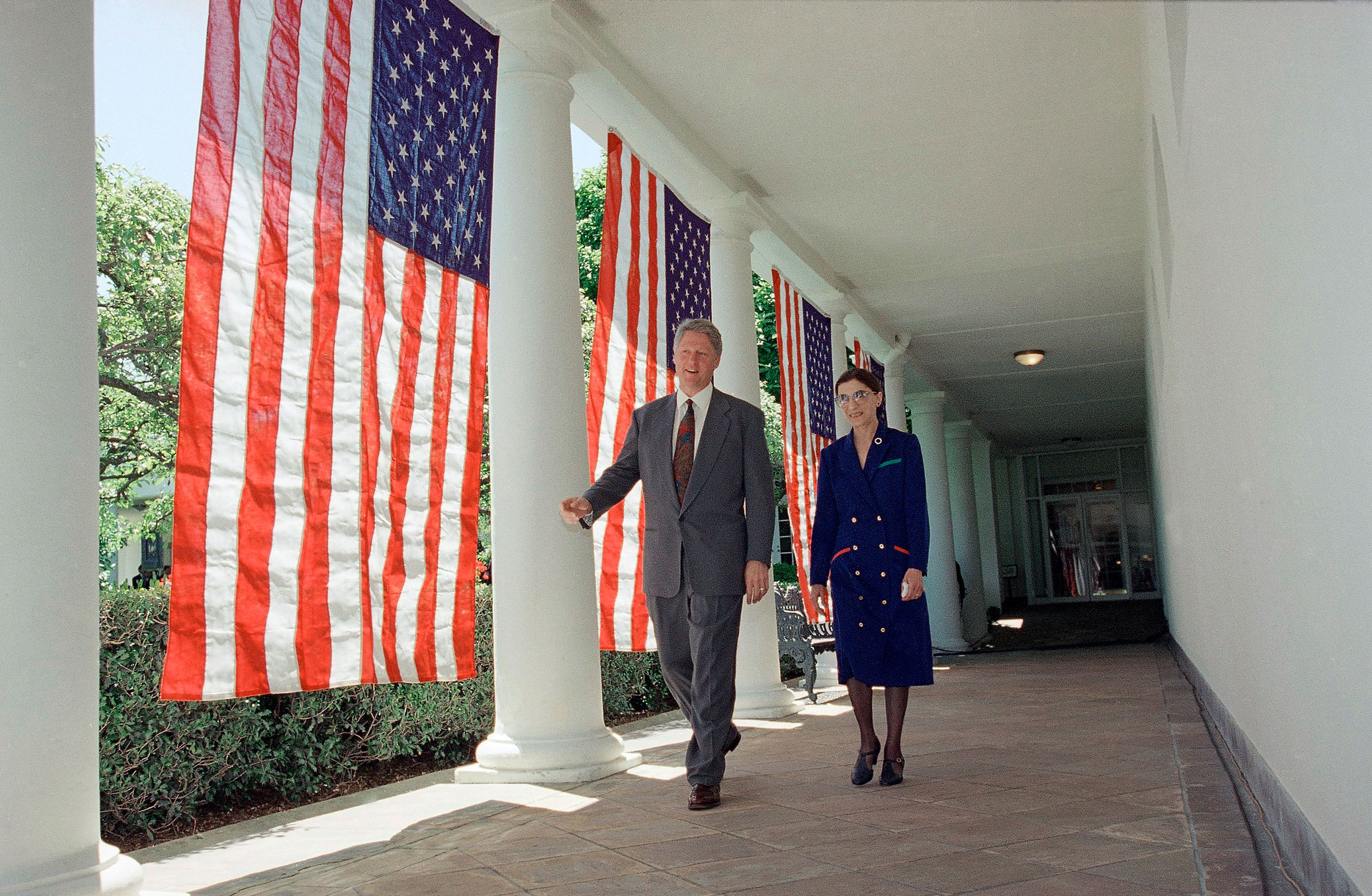 President Bill Clinton and Ruth Bader Ginsburg walk along the Colonnade of the White House on June 14, 1993.