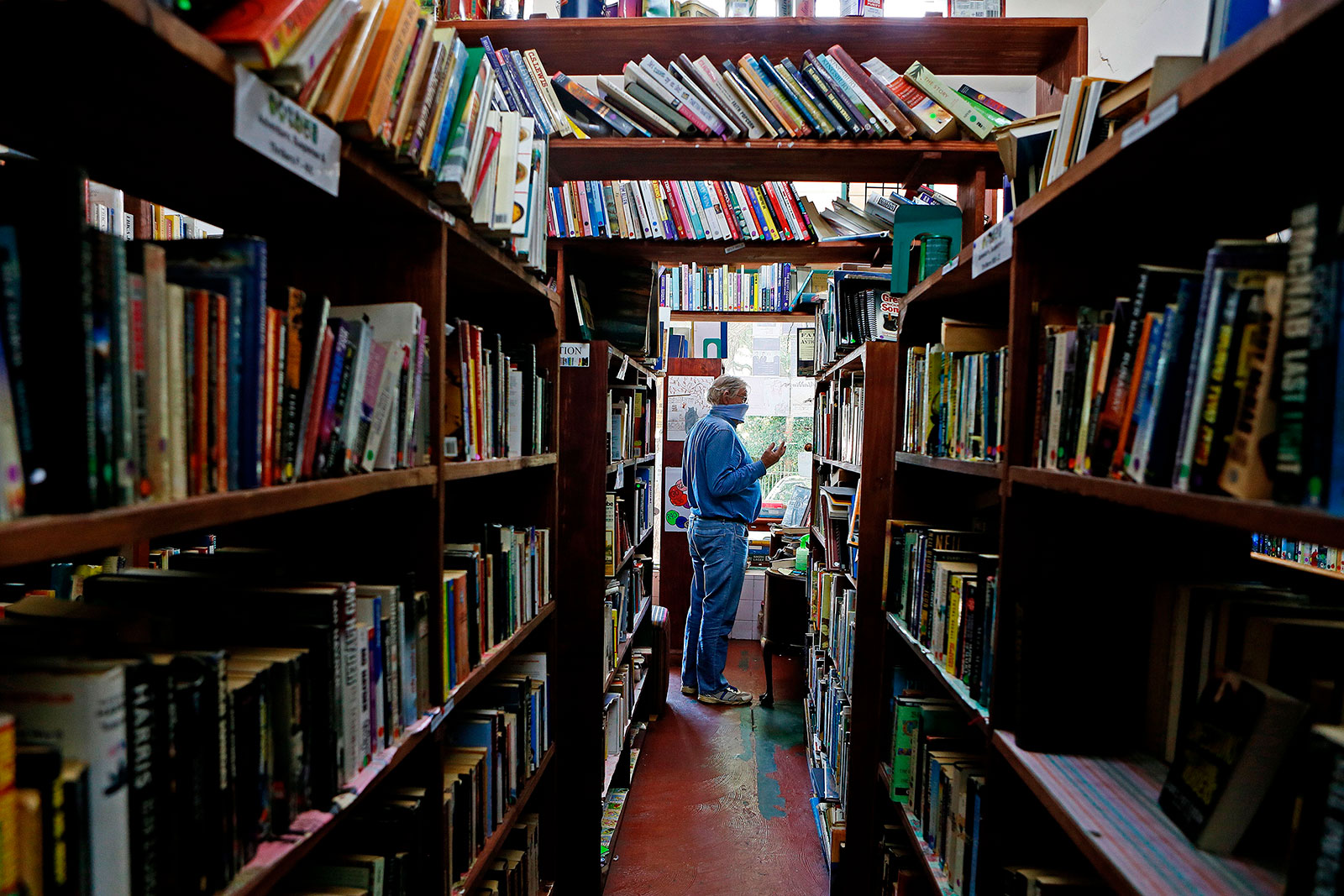 A customer buys a book at Magic Tree Books in Pretoria, South Africa, on May 1.