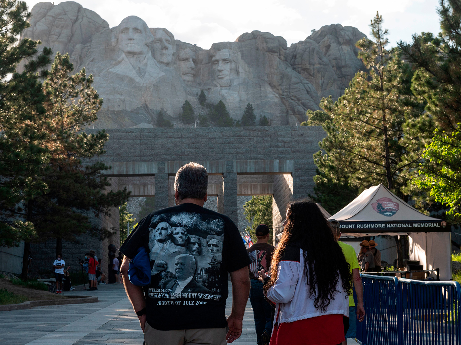 Visitors walk to see the Mount Rushmore National Monument in Keystone, South Dakota on July 2.