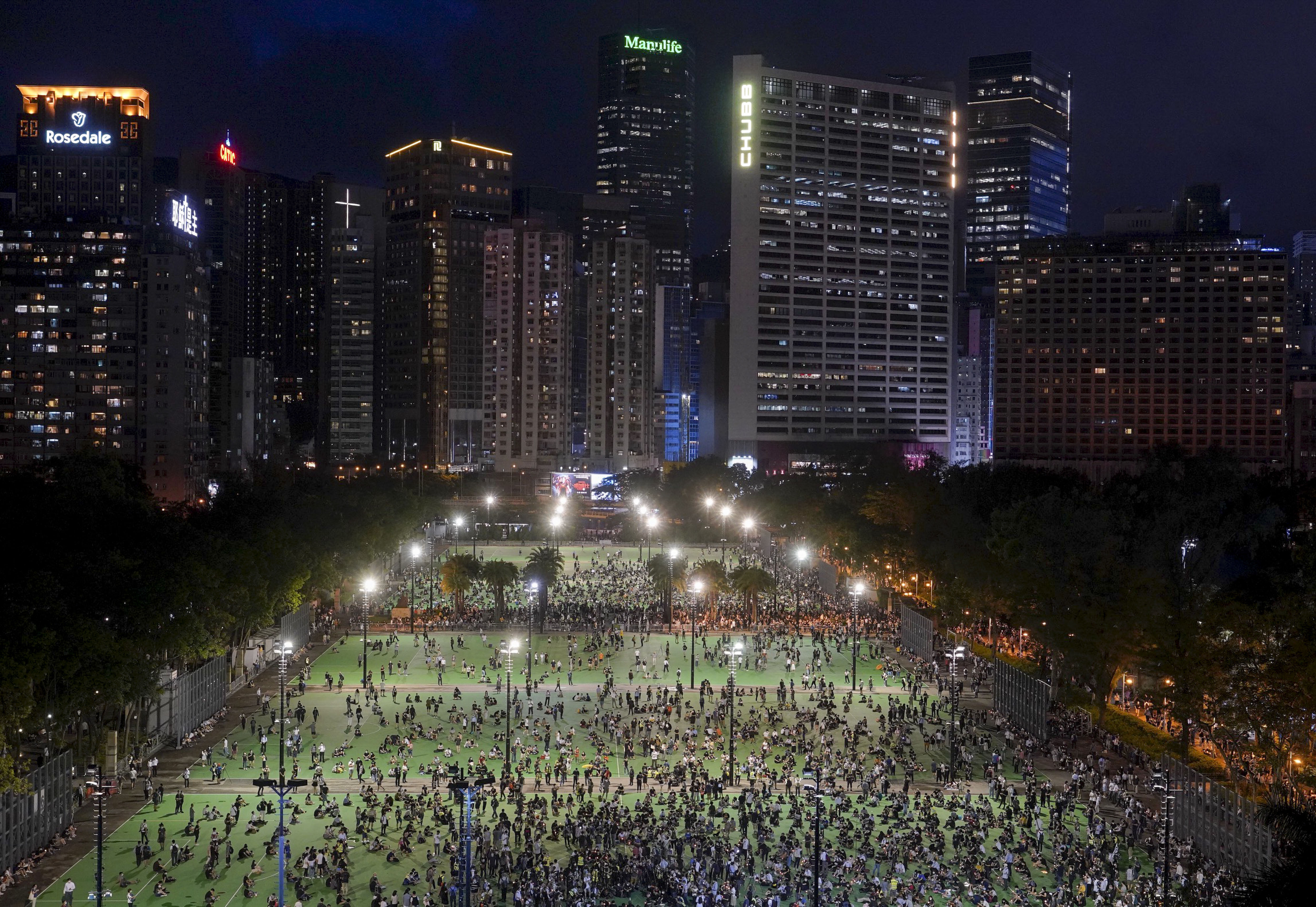 People gather on June 4 at Victoria Park in Hong Kong, for a vigil to remember the victims of the 1989 Tiananmen Square massacre.