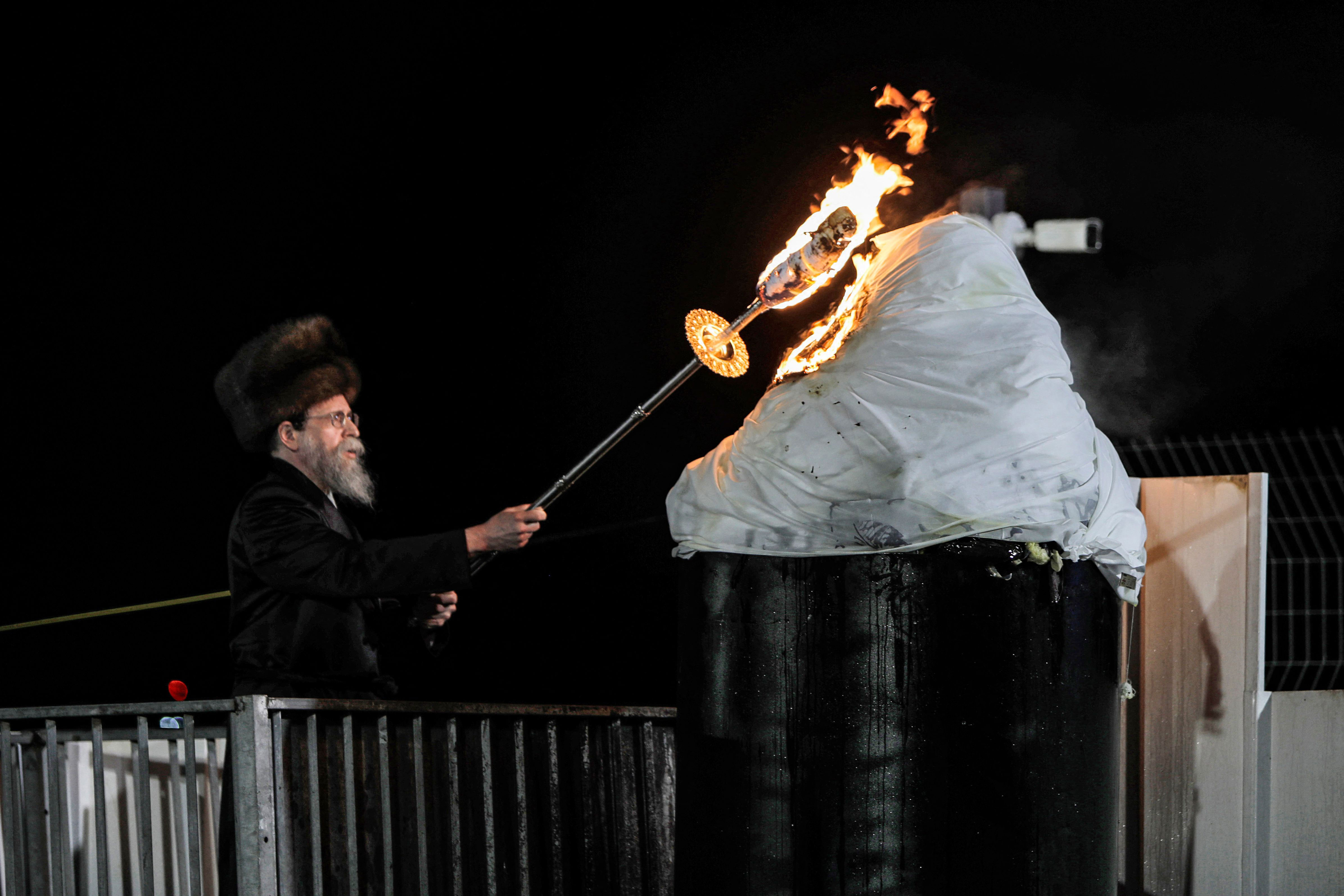 A rabbi lights a bonfire at the grave site of Rabbi Shimon Bar Yochai. Up to 100,000 Jews are estimated to have attended last night's event.