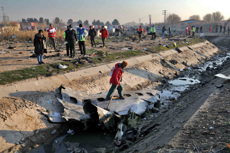 Emergency crews inspect the scene of the plane crash.