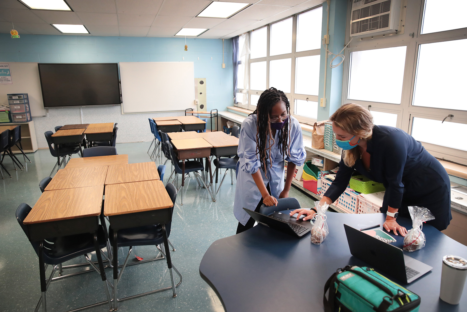 Jasmine Gilliam and Lucy Baldwin, teachers at King Elementary School, prepare to teach their students remotely in empty classrooms during the first day of classes on September 8, in Chicago.