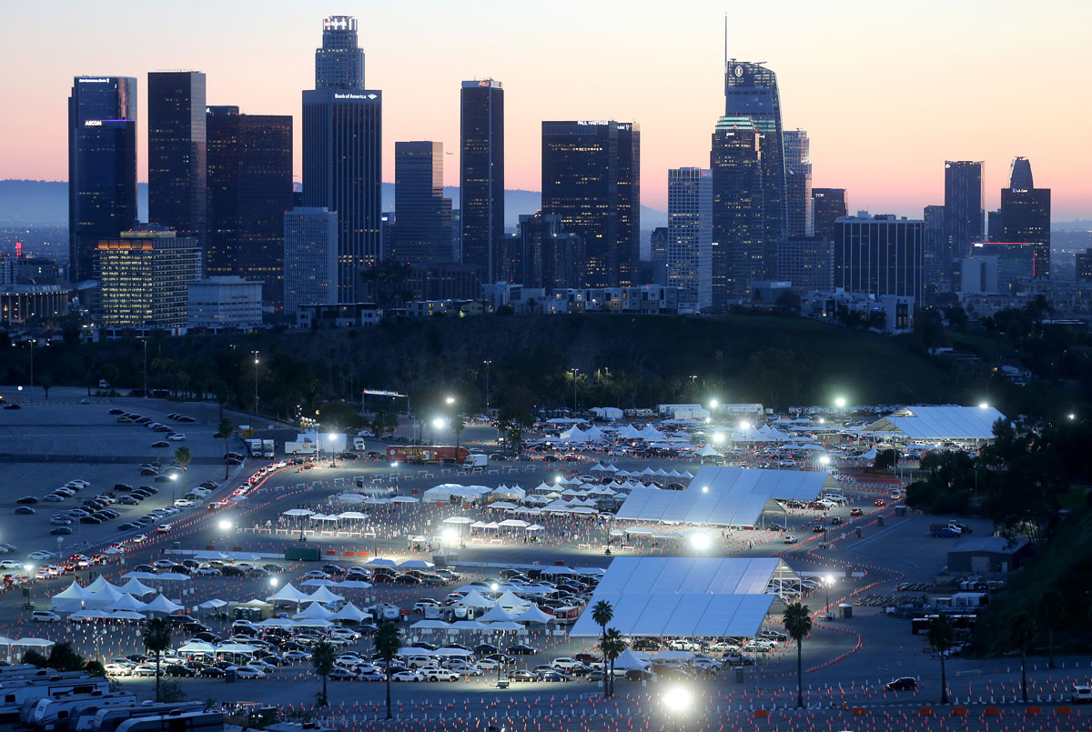 Cars are lined up at the mass Covid-19 vaccination site at Dodger Stadium on February 23 in Los Angeles, California.