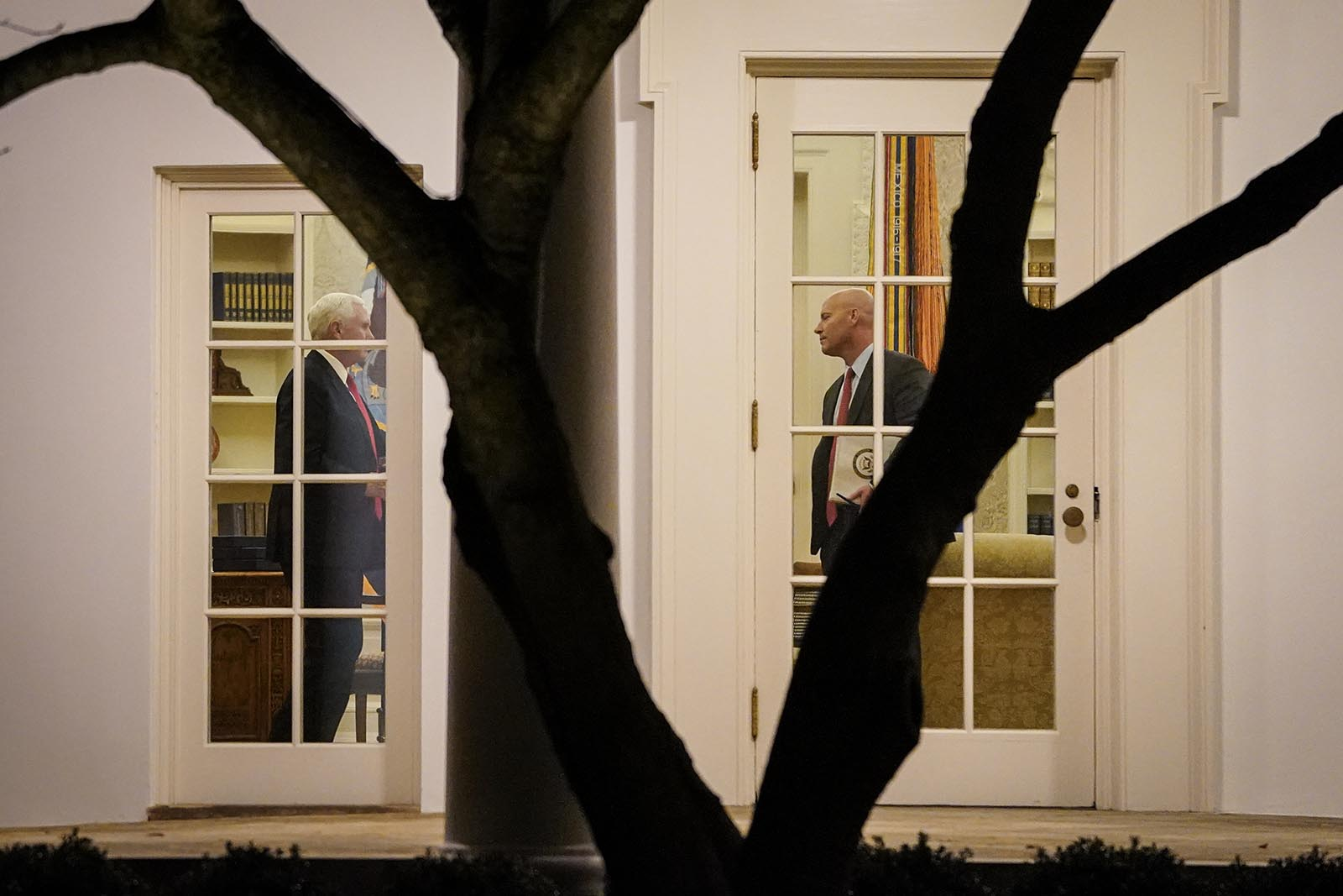 Vice President Mike Pence and his Chief of Staff Marc Short stand in the Oval Office before U.S. President Donald Trump departs the White House on January 4, 2021 in Washington, DC.