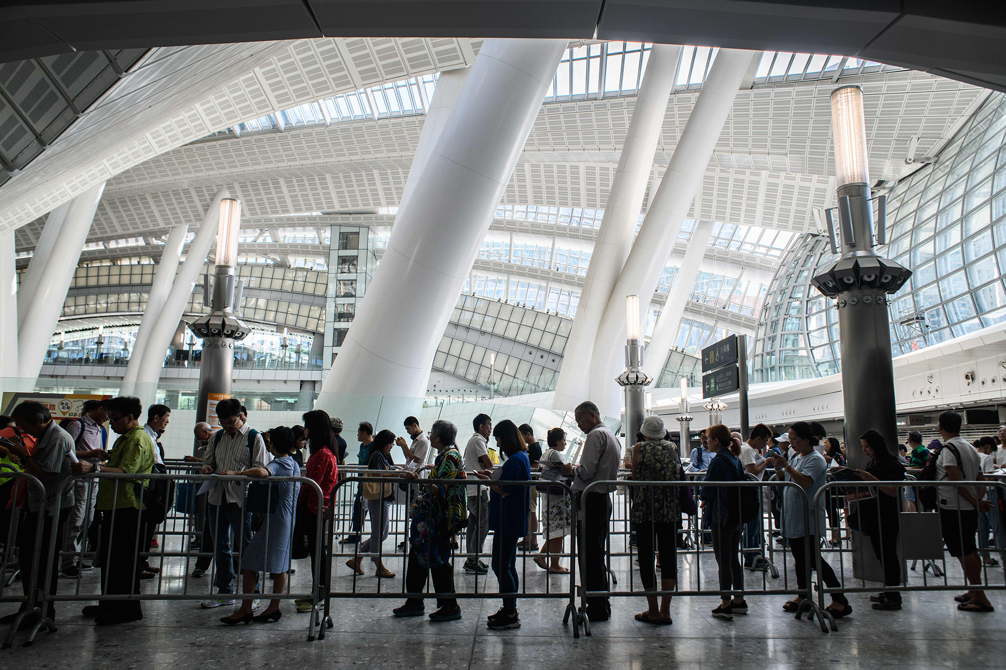 Customers queue to purchase tickets on September 10, 2018.