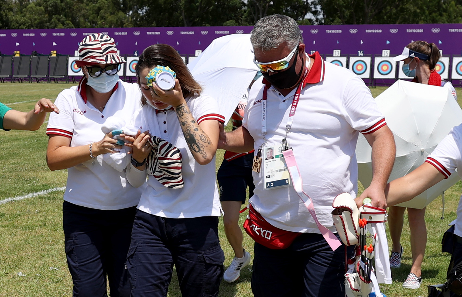 Archer Svetlana Gomboeva is treated for heat exhaustion in the women's individual ranking round during the Olympic Games at Yumenoshima Park Archery Field on July 23, in Tokyo.
