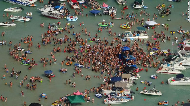 Party-goers at the Torch Lake Sandbar on July 4.