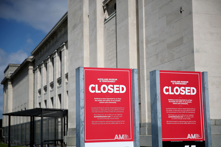 Closed notices relating to the coronavirus are seen outside the entrance to the Auckland War Memorial on March 25 in Auckland, New Zealand.