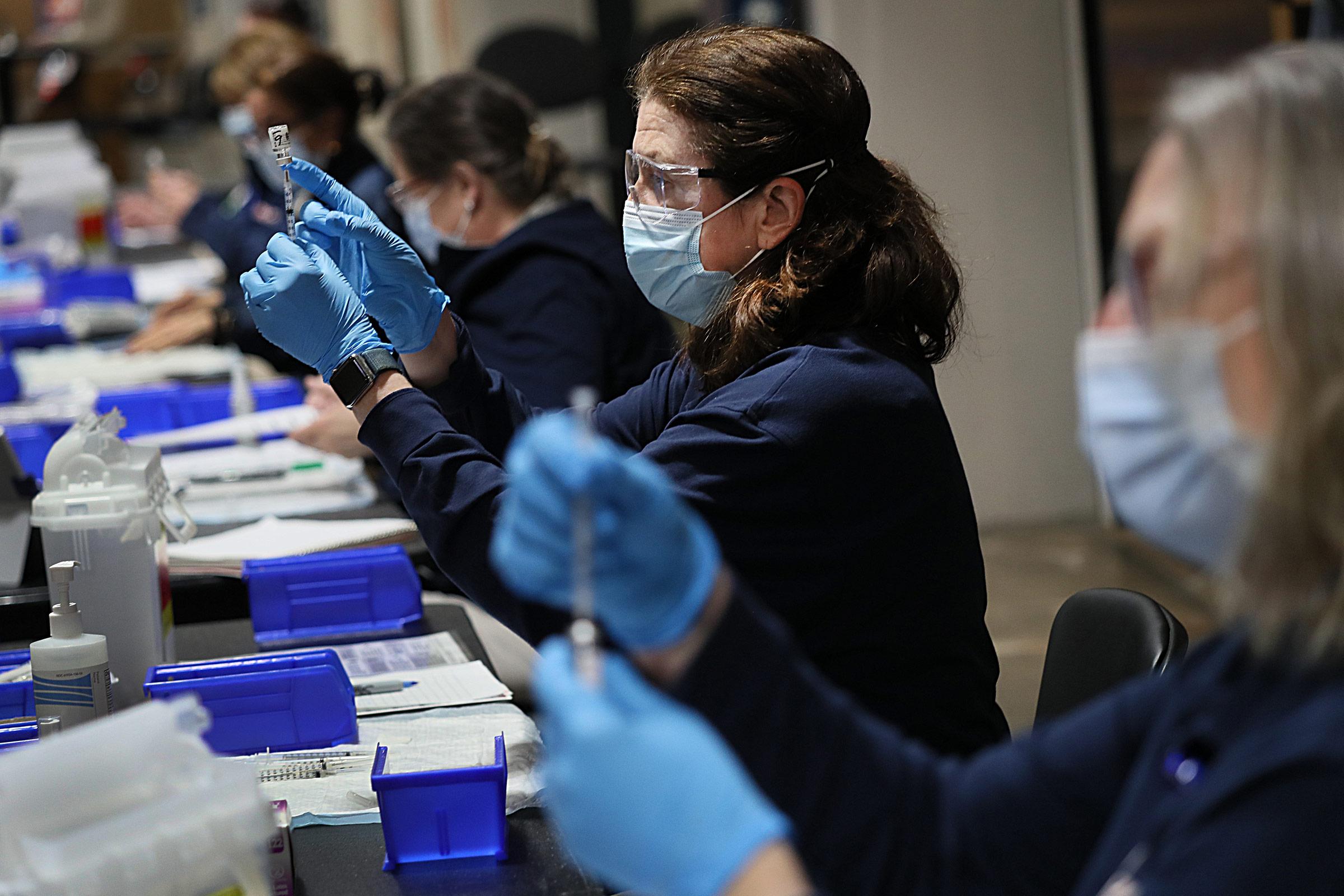 Covid-19 vaccine doses are prepared at the Hynes Convention Center in Boston, Massachusetts, on March 19.