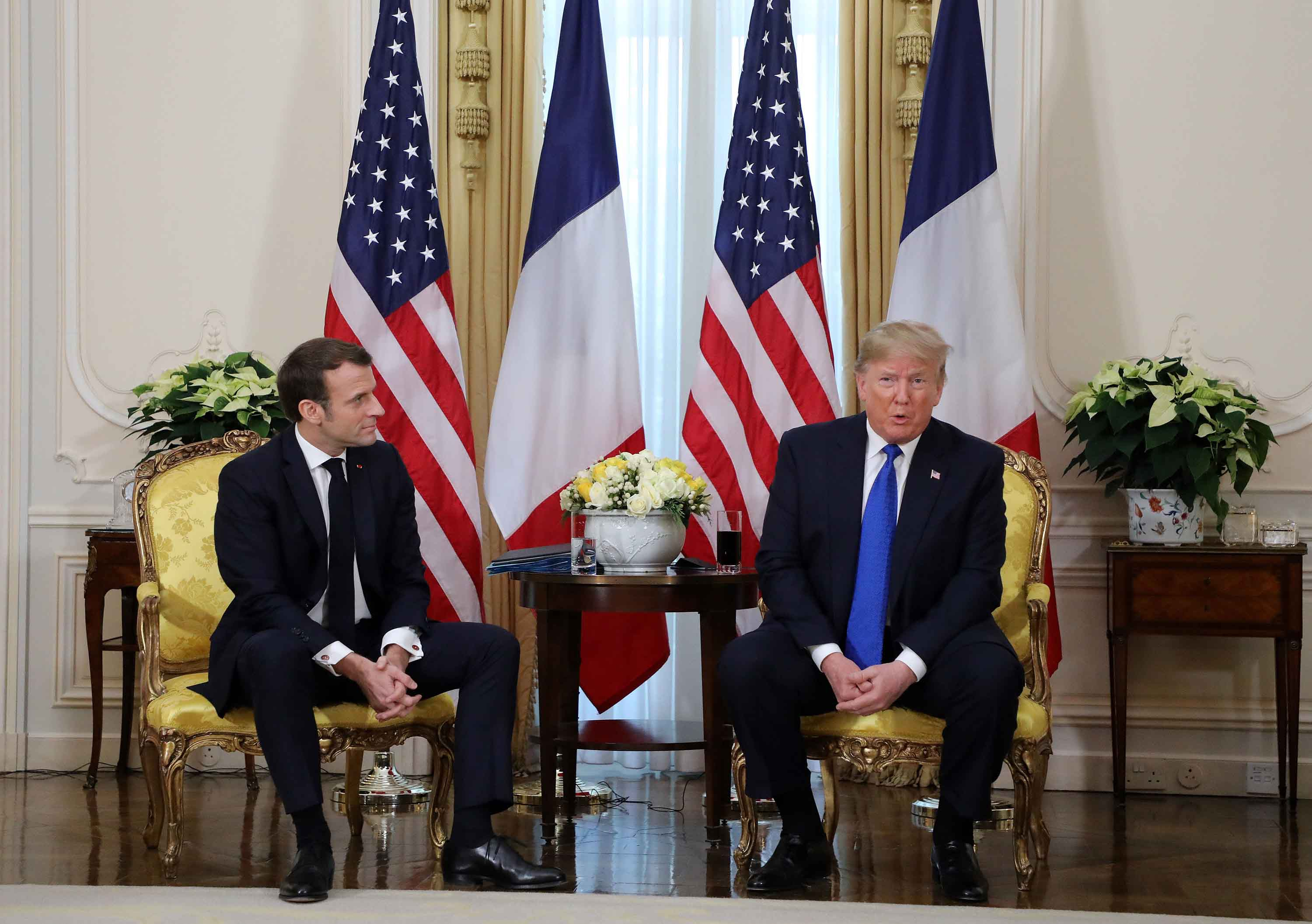 France's President Emmanuel Macron meets with President Trump at Winfield House in London on Tuesday.