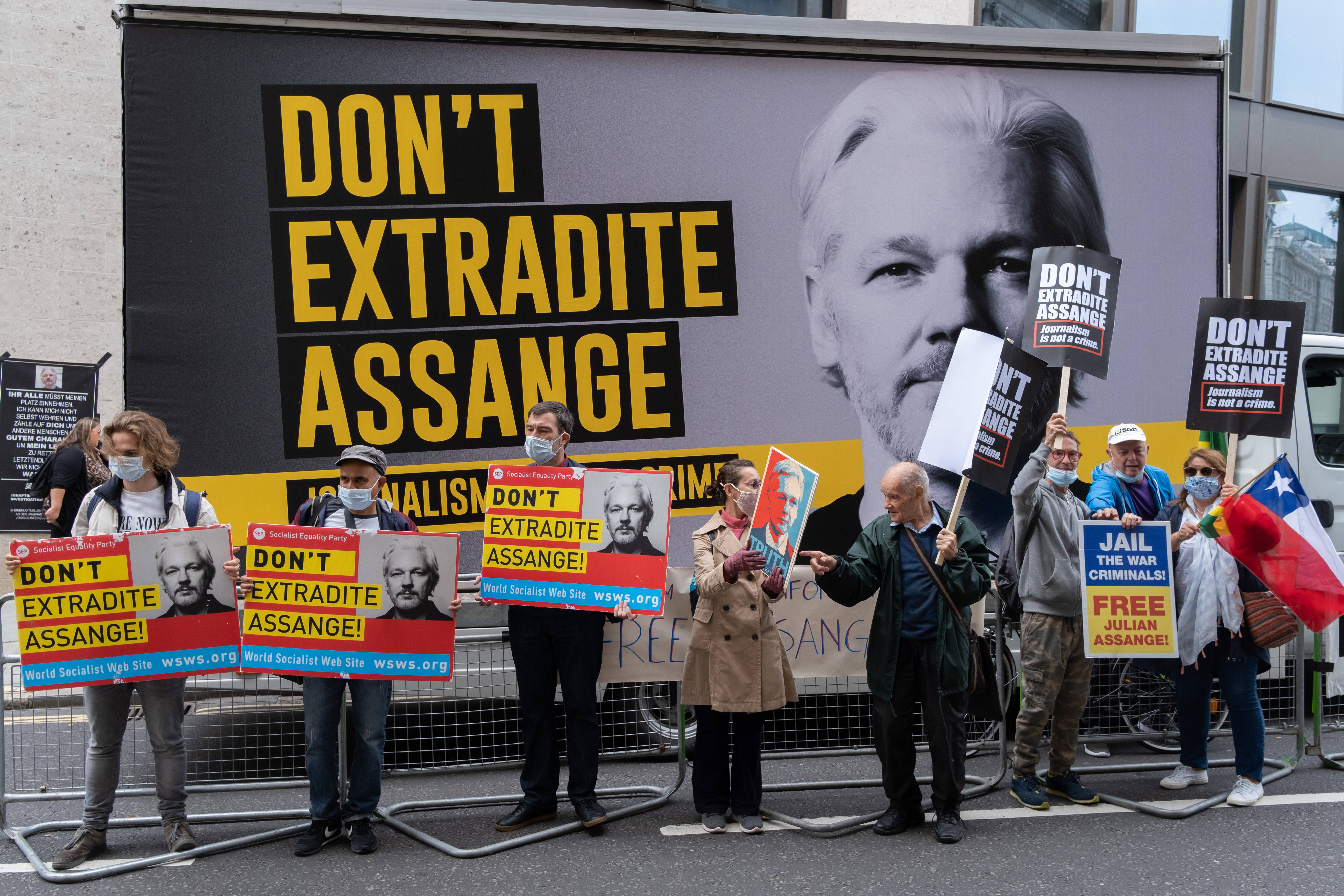 Supporters of Wikileaks founder Julian Assange protest outside London's Old Bailey court on September 7.