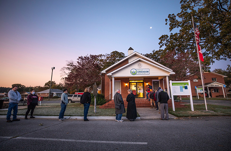 Voters line up to cast their ballots on Election Day, Tuesday, Nov. 3, 2020, in Emerson, Ga.