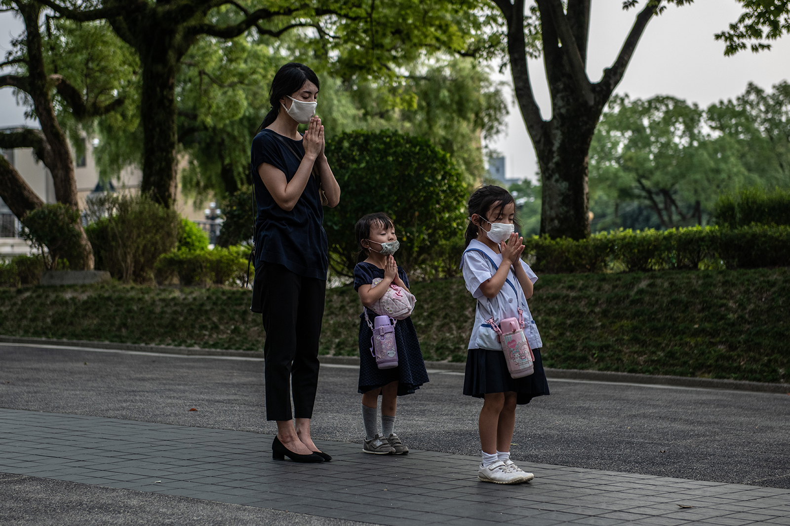 A mother and her daughters pray at the Students Peace Monument on the 75th anniversary of the Hiroshima atomic bombing, on August 6, in Hiroshima, Japan.