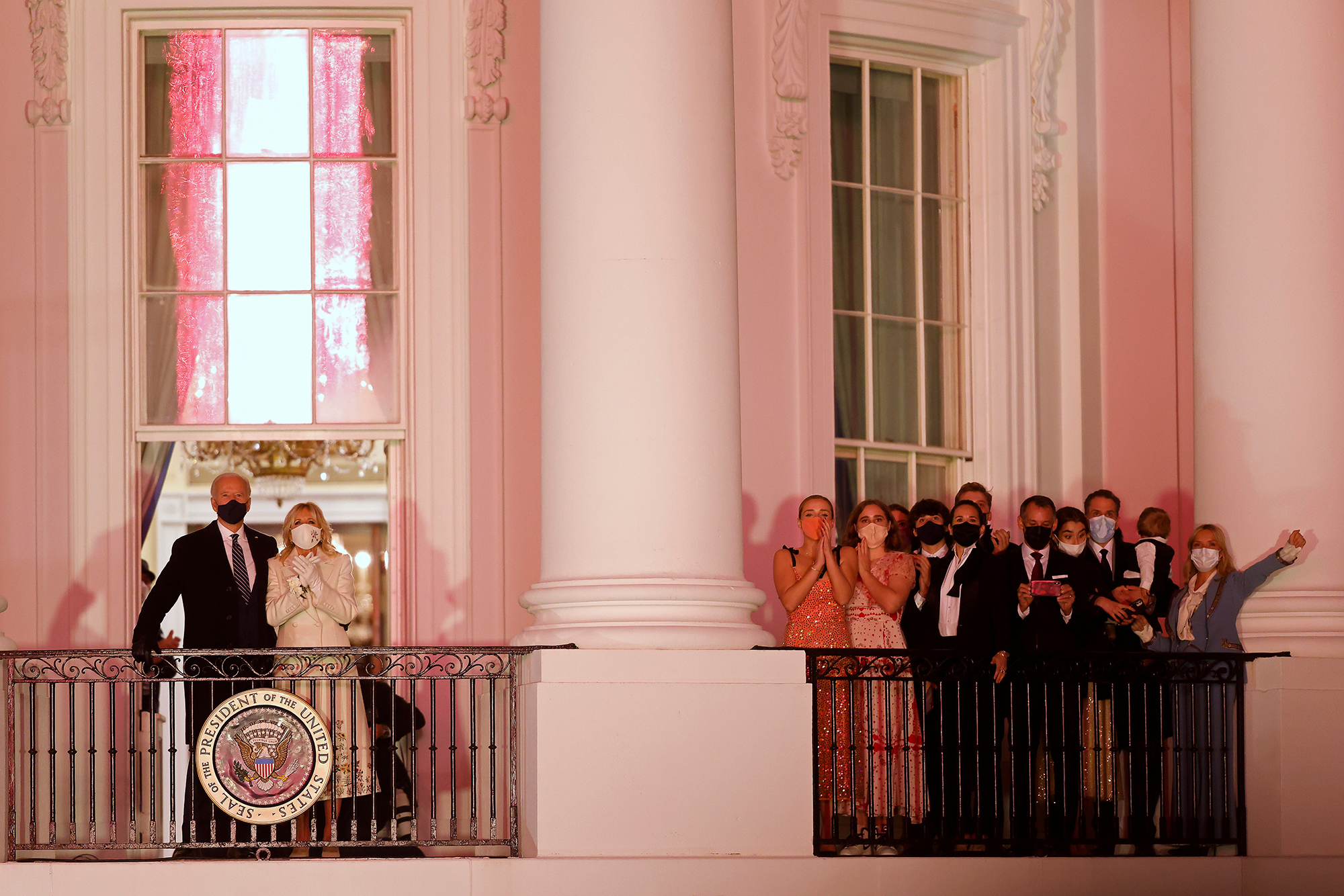 President Joe Biden, first lady Jill Biden, and their family watch fireworks from the White House after his inauguration as the 46th President of the United States on January 20.