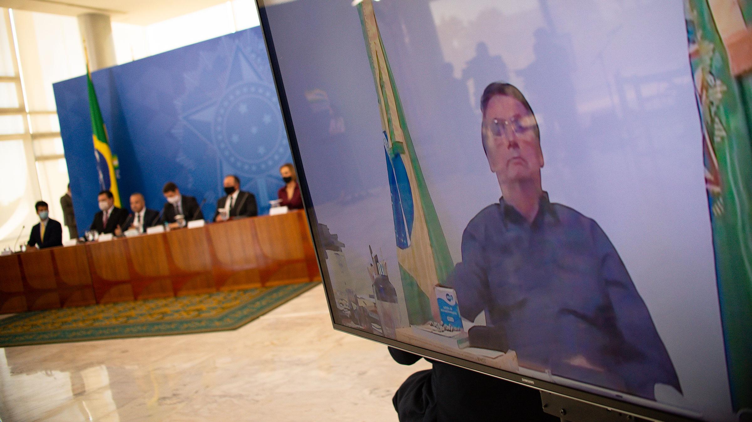 Brazilian President Jair Bolsonaro participates in a ceremony via video conference on Wednesday.