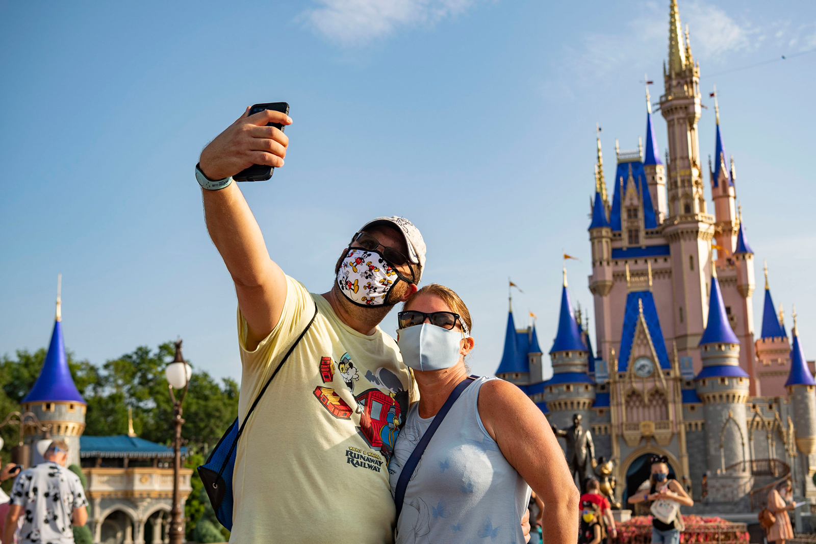 Guests stop to take a selfie at Magic Kingdom Park at Walt Disney World Resort on July 11, in Lake Buena Vista, Florida.