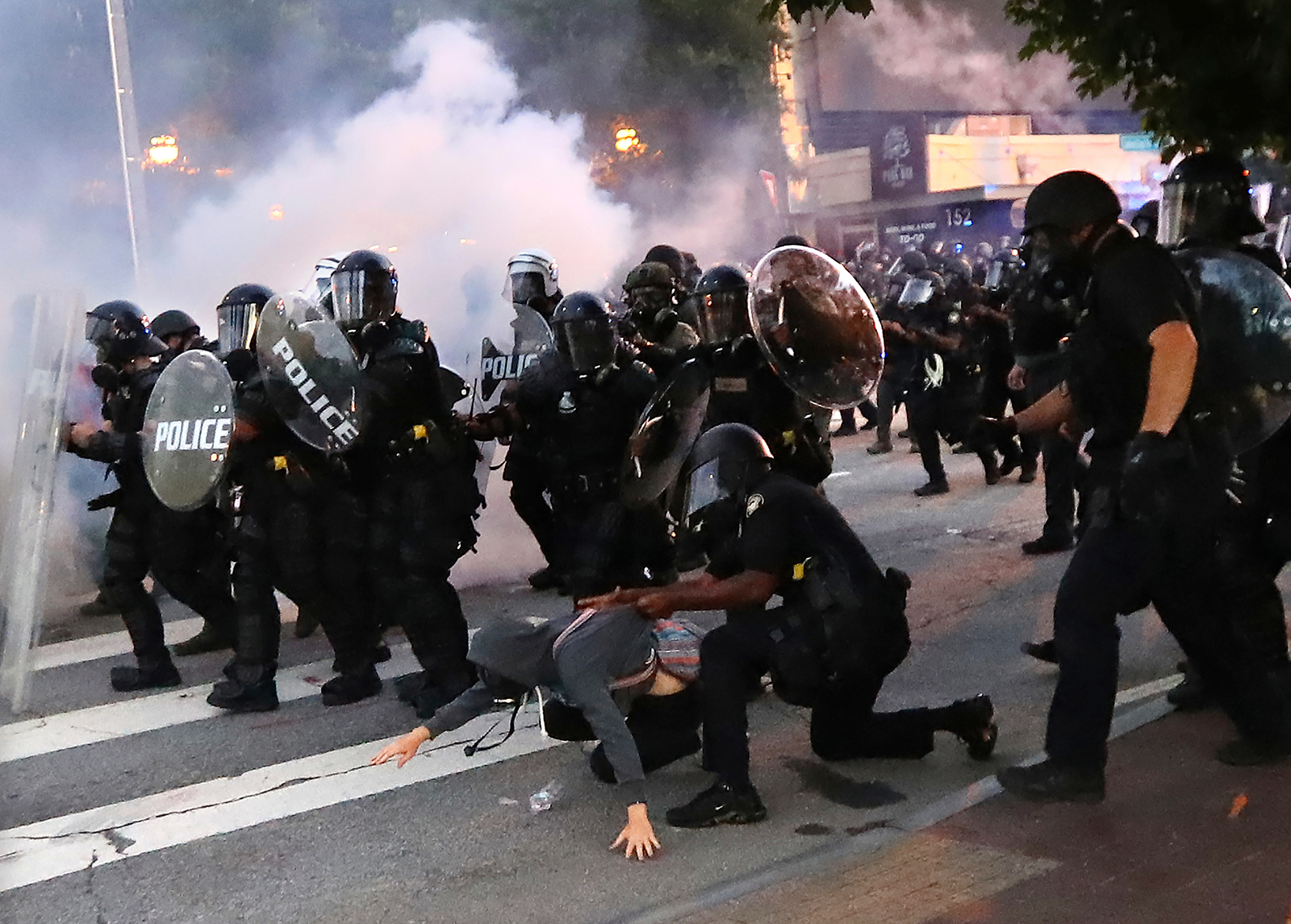 A protester is arrested in Atlanta, on May 31, after throwing tear gas back at police.