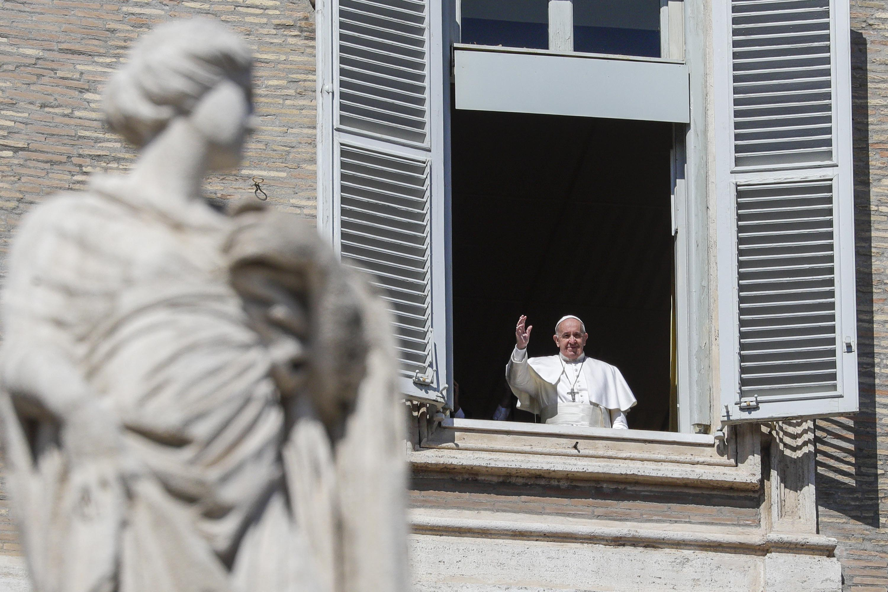 Pope Francis waves from a window overlooking St. Peter's Square at the Vatican on March 8.