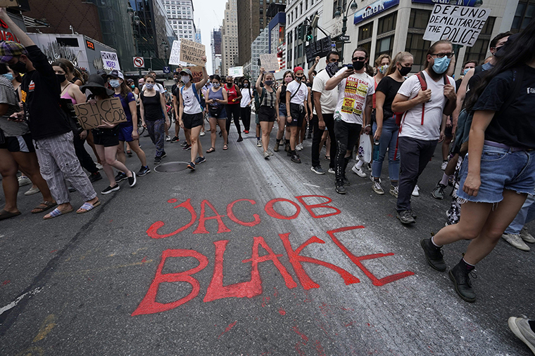 Demonstrators march through the city during a protest in New York on Monday, August 24, against the shooting of Jacob Blake.