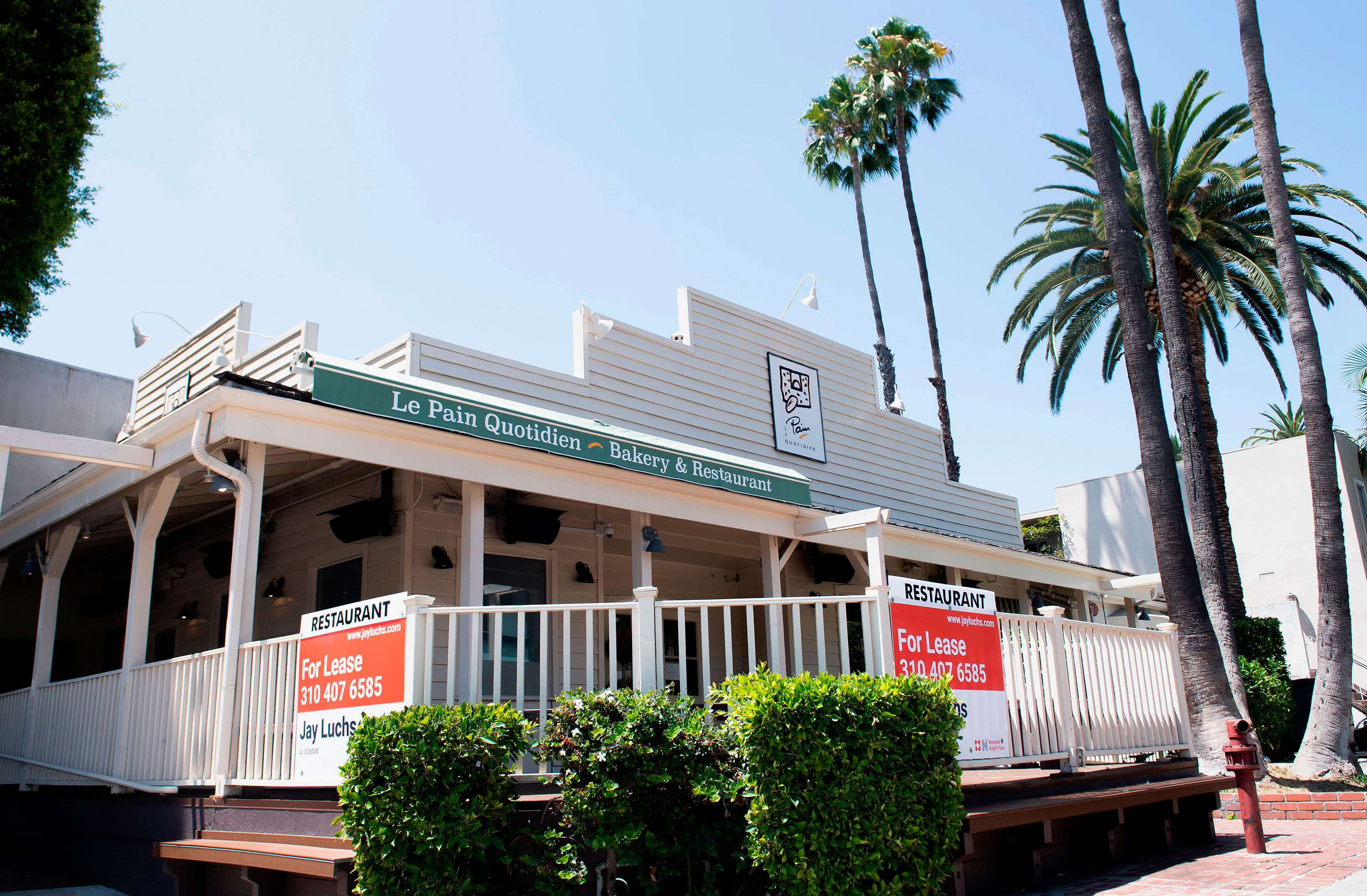For Lease signs are seen on the balcony of a now closed restaurant in West Hollywood, California on August 3.