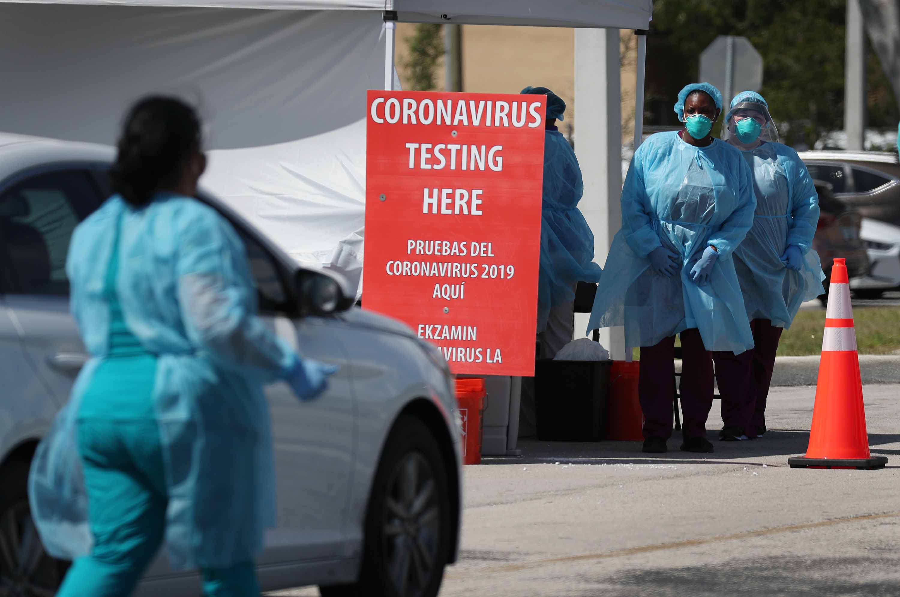 Health care staff prepare to test people for the coronavirus at a health center in Miami, Florida, on March 18.