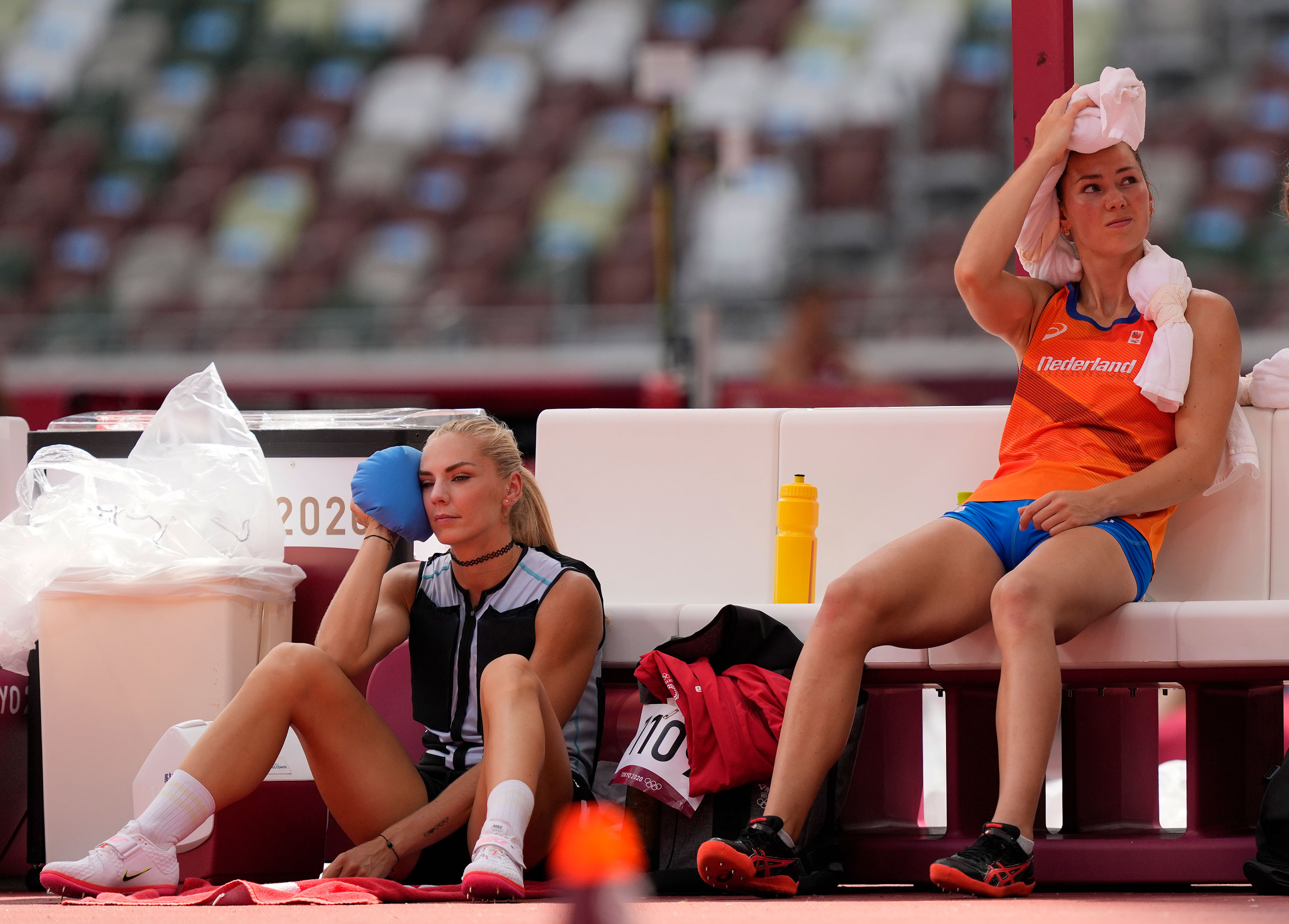 Competitors try to stay cool during the high jump event on August 4.