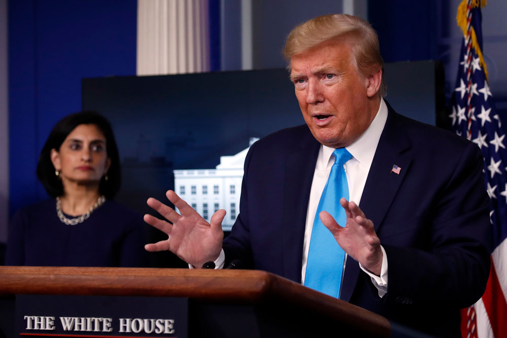 President Donald Trump speaks about the coronavirus in the James Brady Press Briefing Room of the White House, Tuesday, April 7, in Washington, as Administrator of the Centers for Medicare and Medicaid Services Seema Verma, listens.