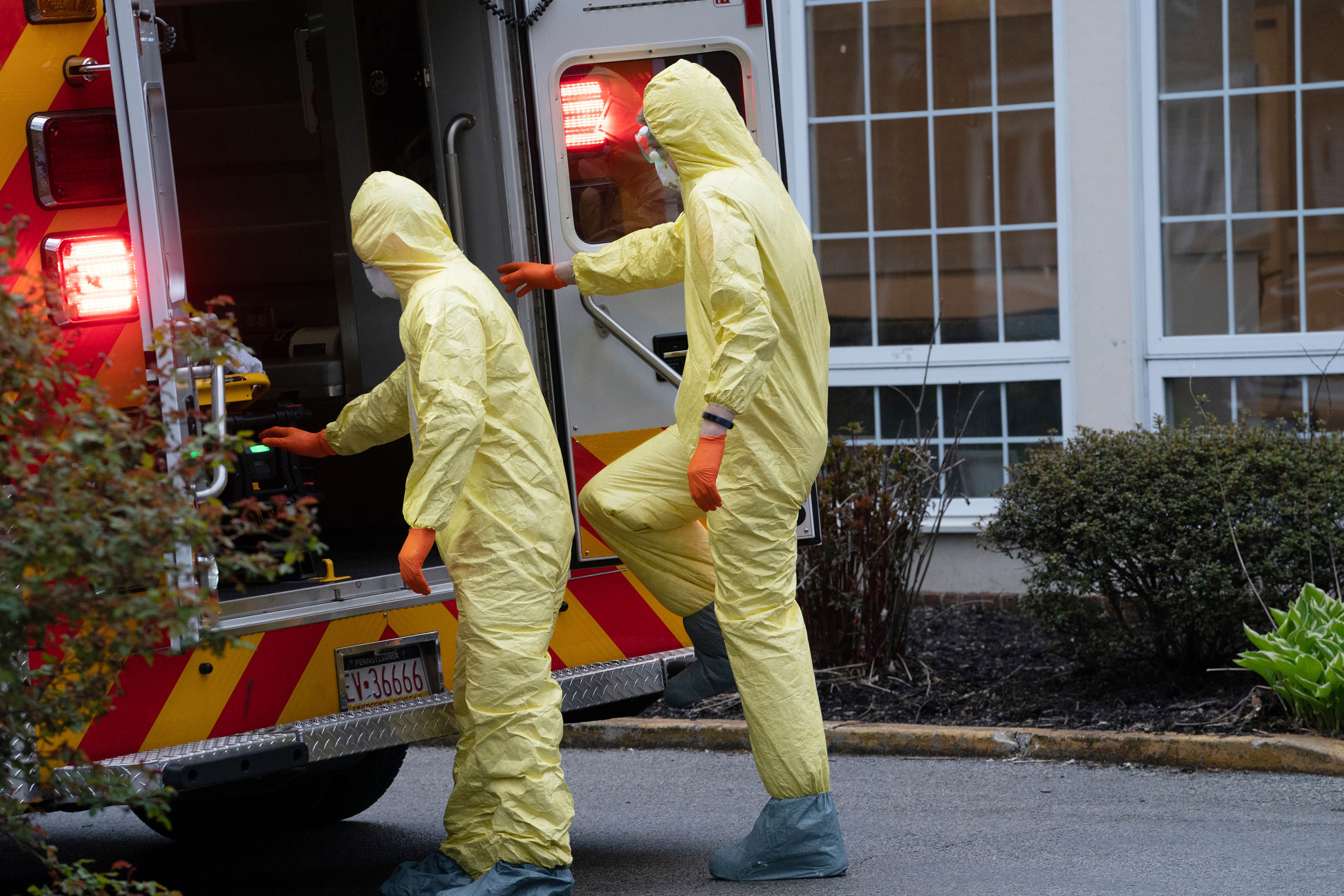 Paramedix full personal protective equipment (PPE) during a call at a nursing home in Bryn Mawr, Pa. The company responds to 911 calls across five towns that straddle Montgomery and Delaware Counties: Lower Merion, Narberth, Haverford, Conshohocken, and West Conshohocken. (Jessica Griffin/The Philadelphia Inquirer via AP)