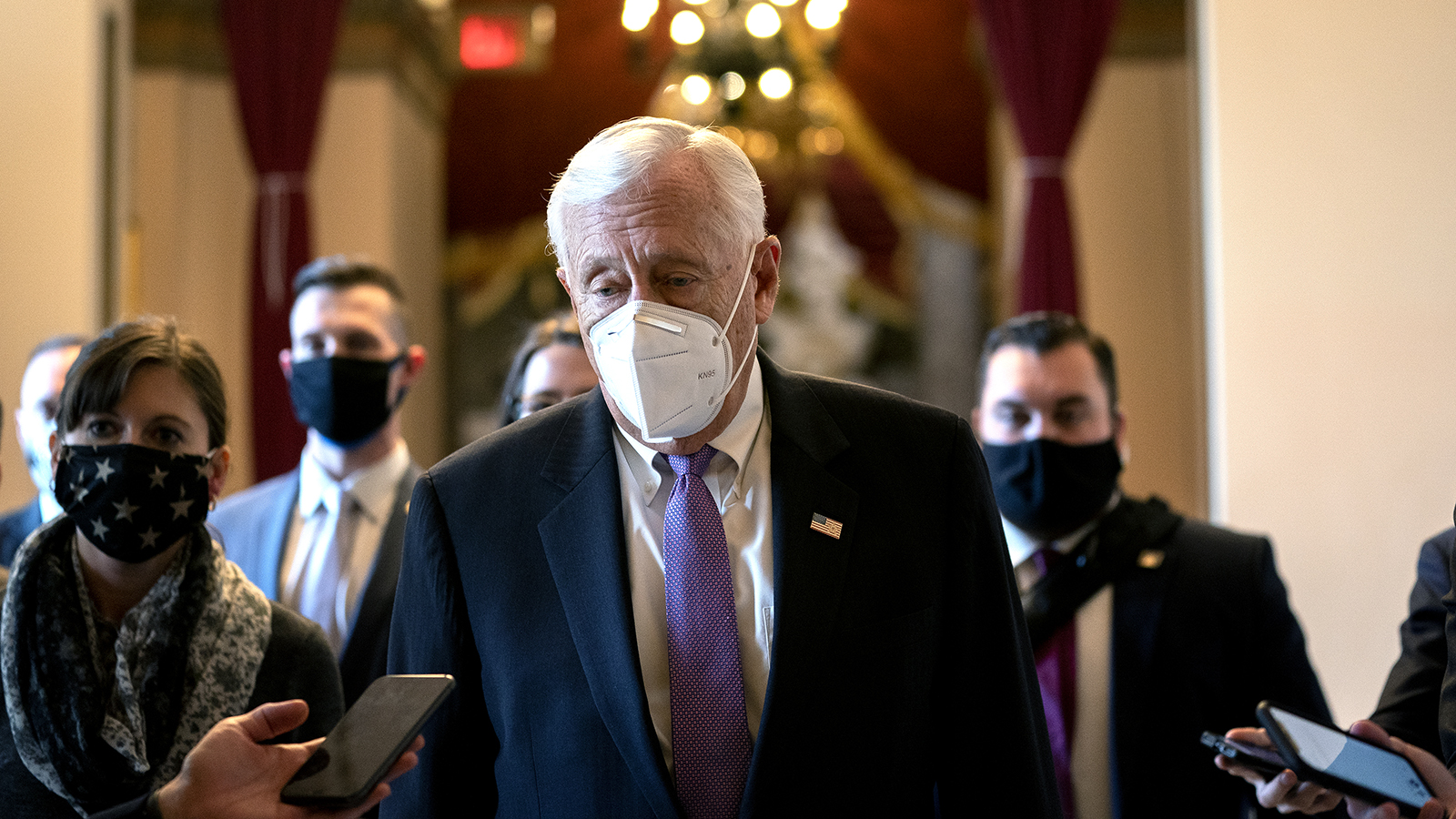 House Majority Leader Steny Hoyer speaks to reporters while walking to the House Floor at the US Capitol on January 13 in Washington.
