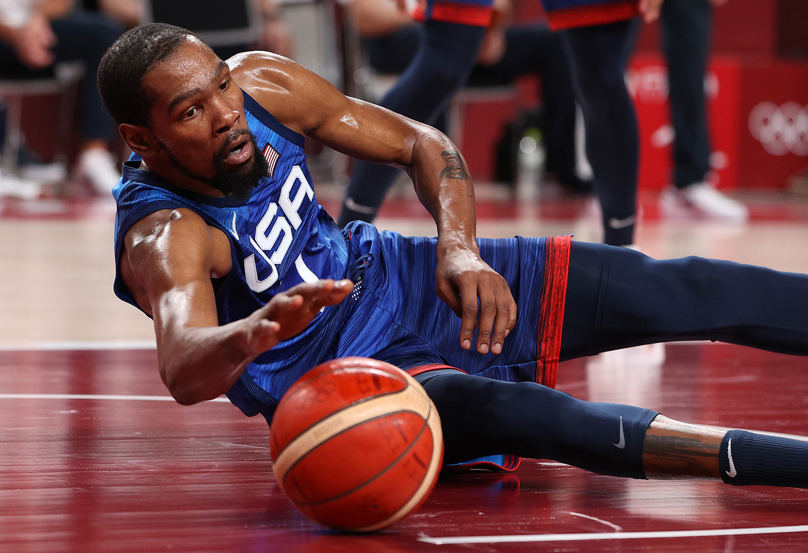 Team USA's Kevin Durant dives for a loose ball against Spain during the second half of their men's basketball quarterfinal at the Tokyo 2020 Olympic Games at Saitama Super Arena on Tuesday.