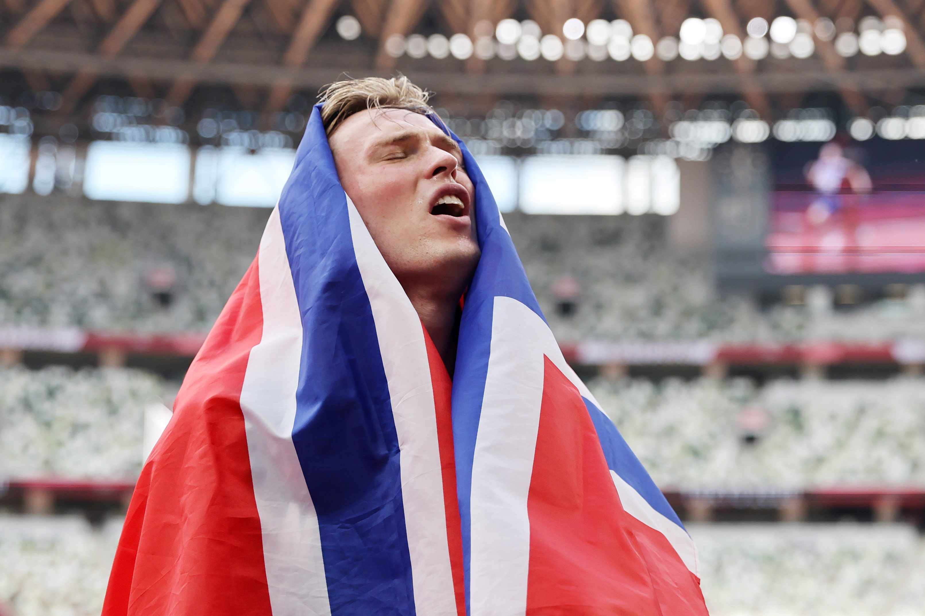 Norway's Karsten Warholm celebrates winning the gold medal in the 400 meters hurdles final on Tuesday.