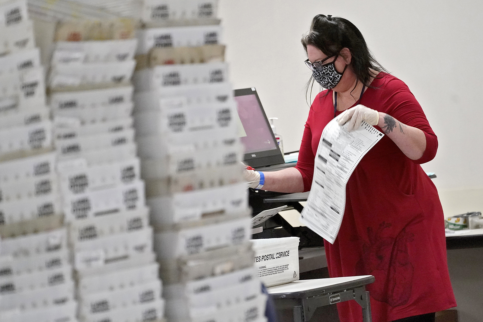 Arizona elections officials continue to count ballots inside the Maricopa County Recorder's Office, Friday, November 6, in Phoenix.