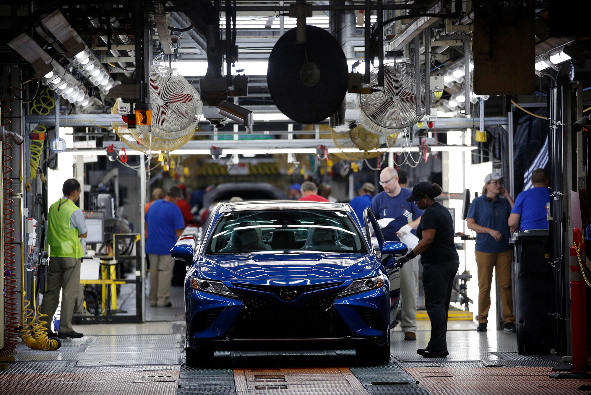 Workers inspect Camry vehicles at the Toyota plant in Georgetown, Kentucky, on Thursday, August 29, 2019.