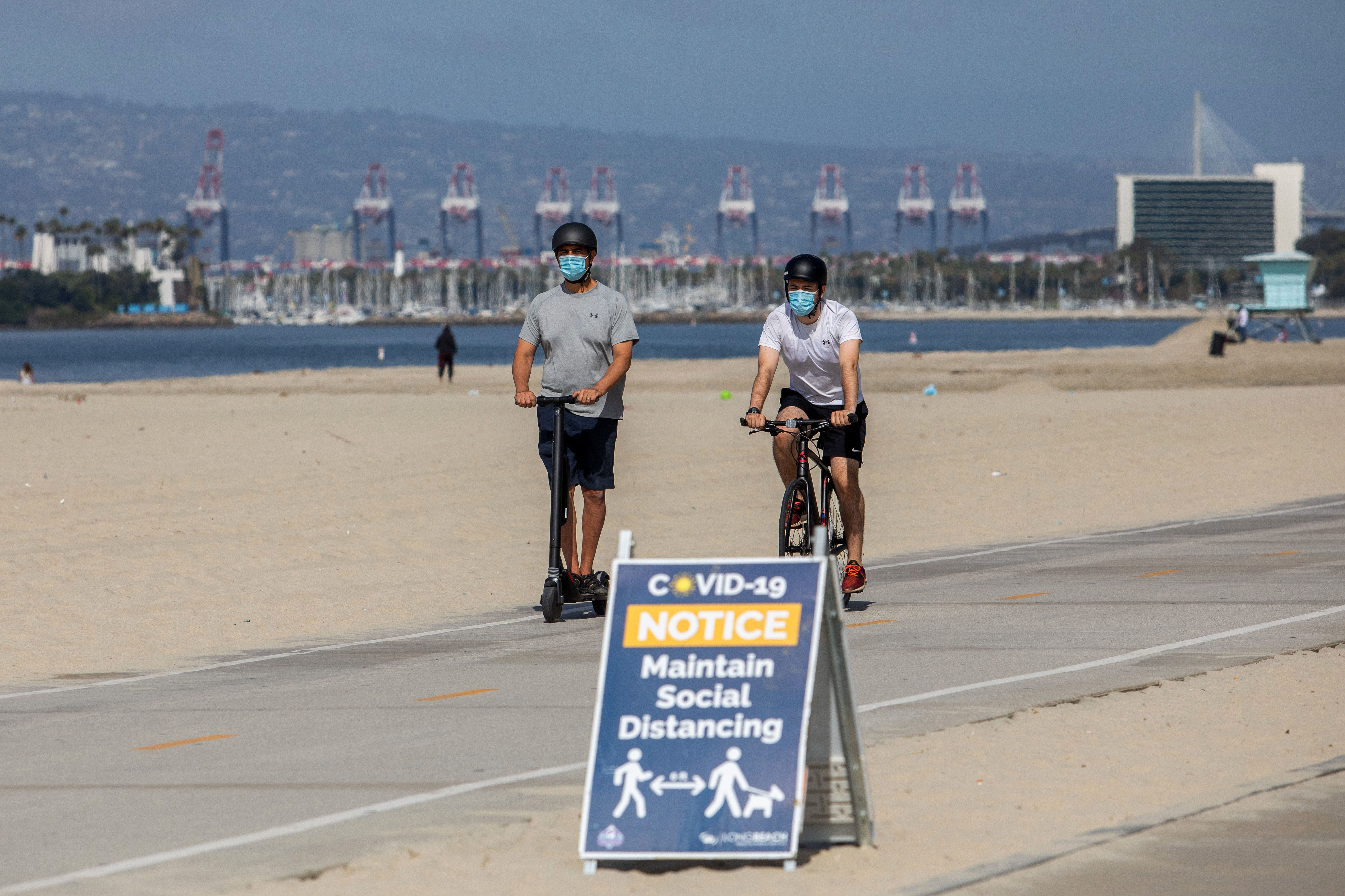 A sign about social distancing is seen on July 14 in Long Beach, California.