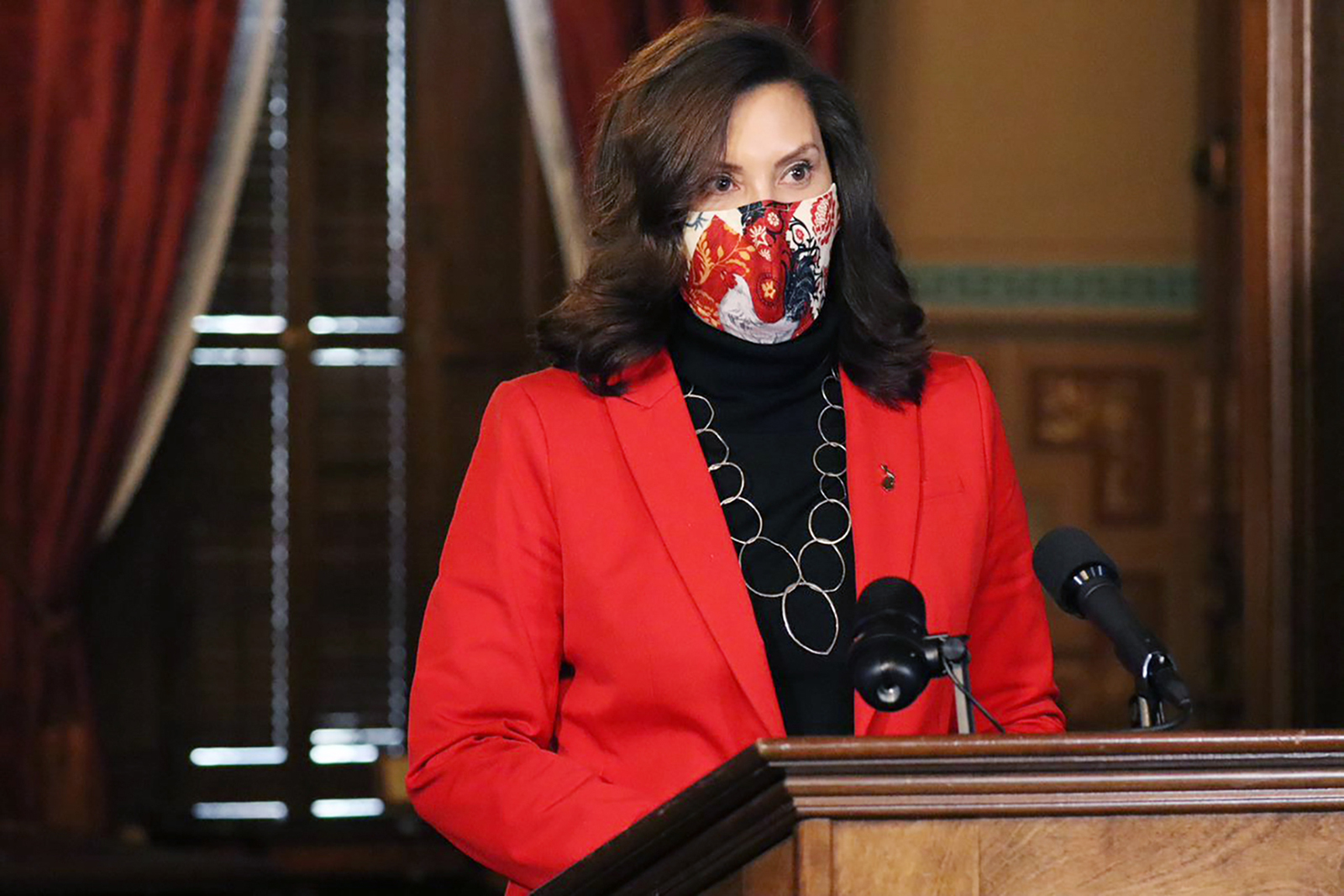 Gov. Gretchen Whitmer addresses the state during a speech in Lansing, Michigan on Tuesday, Dec. 15.
