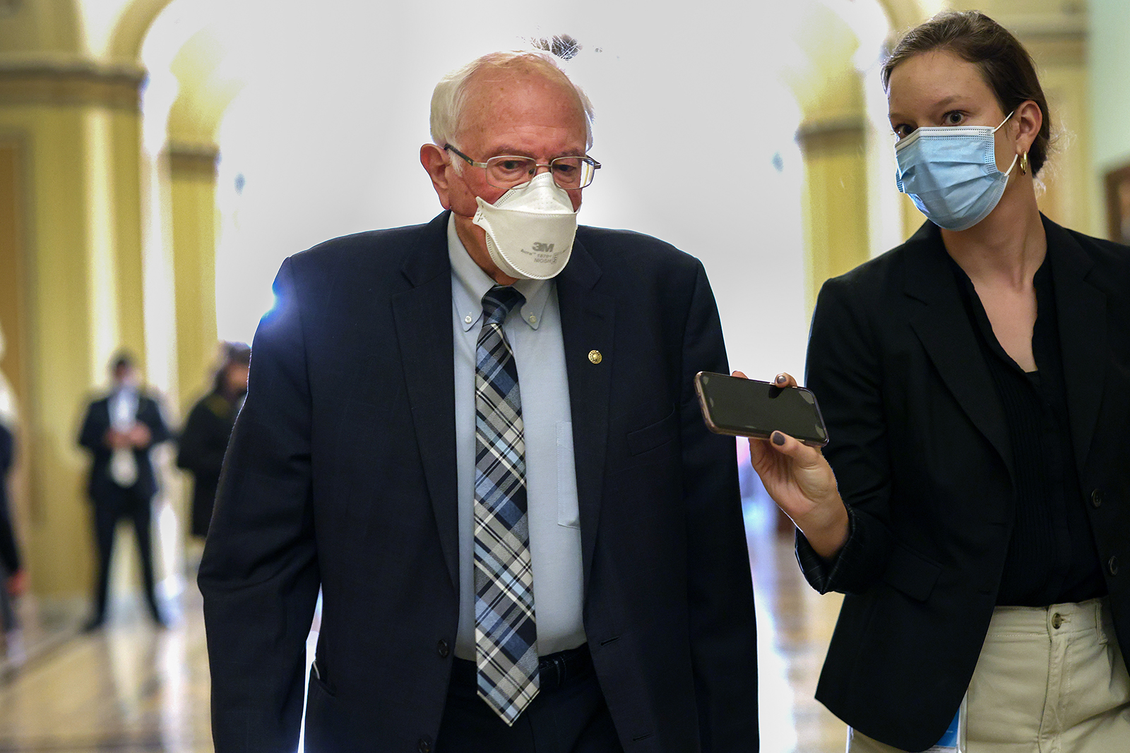 Sen. Bernie Sanders walks to a Democratic policy luncheon at the U.S. Capitol on September 14, in Washington.