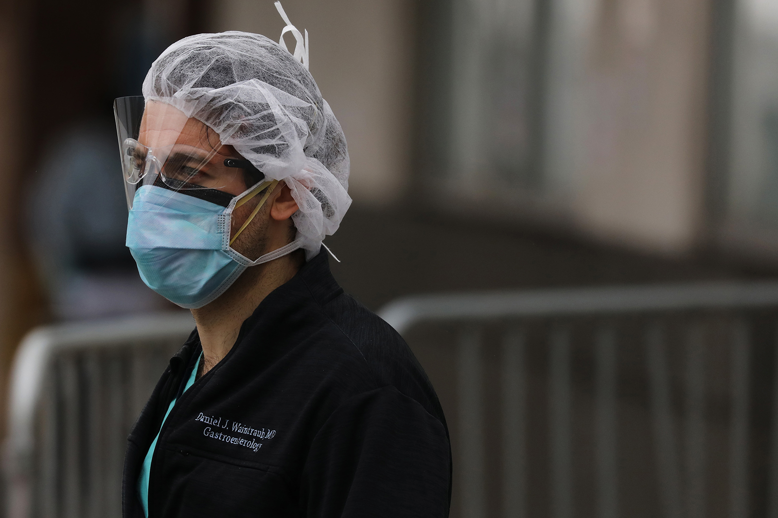 A medical worker stands outside of a special coronavirus intake area at Maimonides Medical Center on April 27, in New York City.