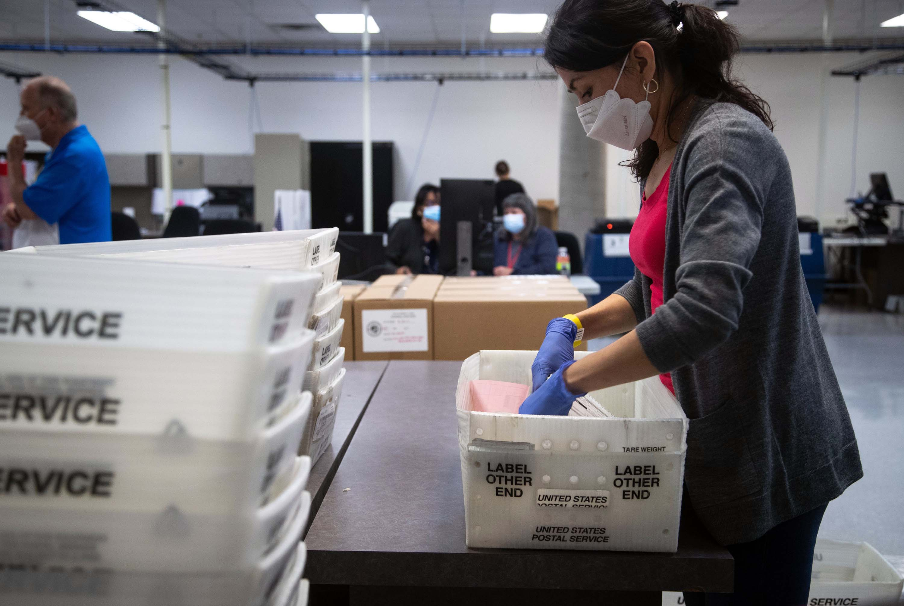 Maricopa County Elections employee Alba Parra tabulates early ballots at the Maricopa County Elections Headquarters in Phoenix, Arizona on November 4.